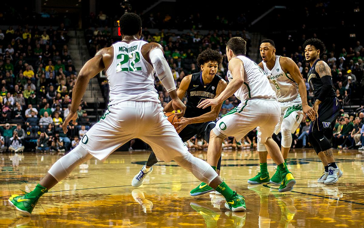 Washington Huskies guard Matisse Thybulle (#4) is rushed by Oregon Ducks defense. The Oregon Ducks defeated the Washington Huskies 65-40 on Thursday night at Matthew Knight Arena. Troy Brown, Junior led Oregon with 21 points to match his career high, and Kenny Wooten set a career best of seven shots blocked. The Ducks now stand 6-5 in the Pac-12 conference play. Photo by Abigail Winn, Oregon News Lab
