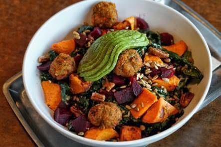 Feed Co.'s Boosted Bowl; chocked full of kale, avocado, roasted yam, lentils, pecans, sunflower seeds, chickpea croquettes, beets, and tied together with a lemon-tahini sauce. (Image: Justin Oba)<p></p>