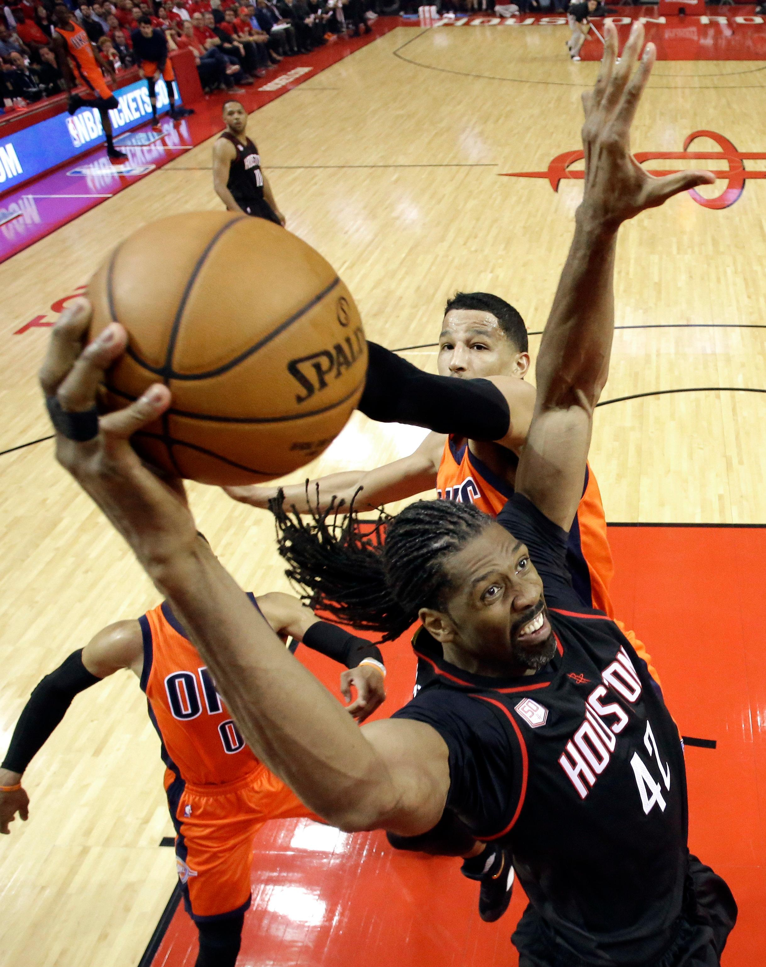Houston Rockets' Nene (42) goes up for a shot as Oklahoma City Thunder's Andre Roberson defends during the first half in Game 1 of an NBA basketball first-round playoff series, Sunday, April 16, 2017, in Houston. (AP Photo/David J. Phillip)