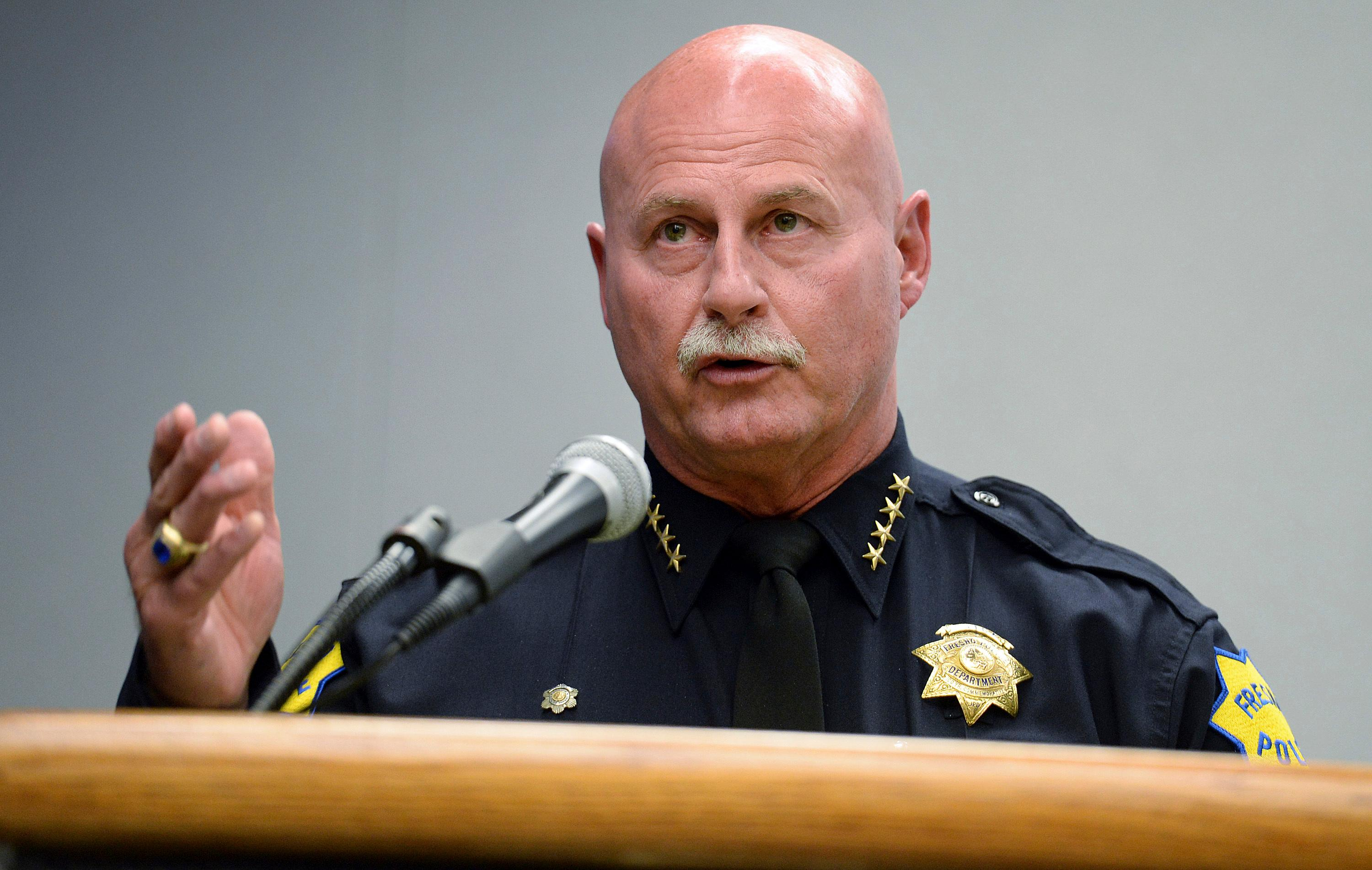 Fresno Police Chief Jerry Dyer holds a news conference to go over details of Tuesday's triple homicide shooting in Fresno, Calif., at the Fresno Police Department on Wednesday, April 19, 2017. The black gunman suspected of killing three white men in a racially motivated attack in Fresno was proud of what he had done and laughed many times as he explained his actions in interviews with police, authorities said Wednesday. (Craig Kohlruss/The Fresno Bee via AP)