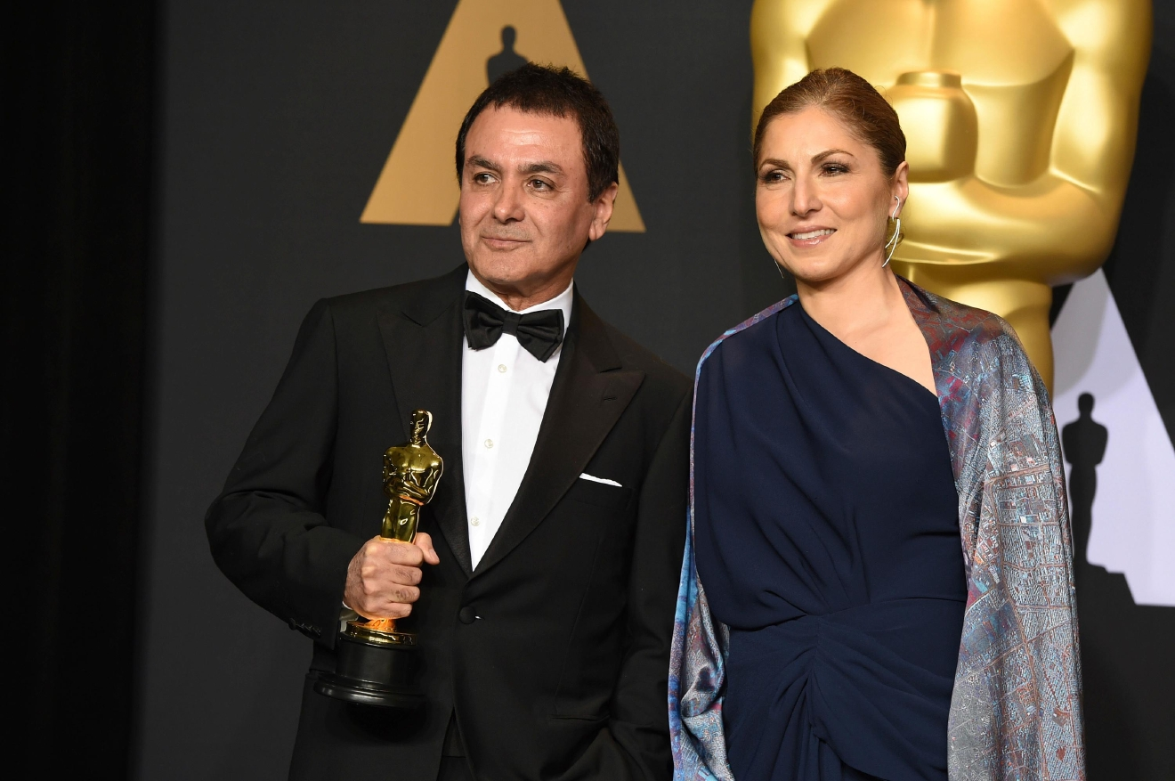 Dr. Firouz Naderi, left, and Anousheh Ansari pose in the press room at the Oscars on Sunday, Feb. 26, 2017, at the Dolby Theatre in Los Angeles. (Photo by Jordan Strauss/Invision/AP)