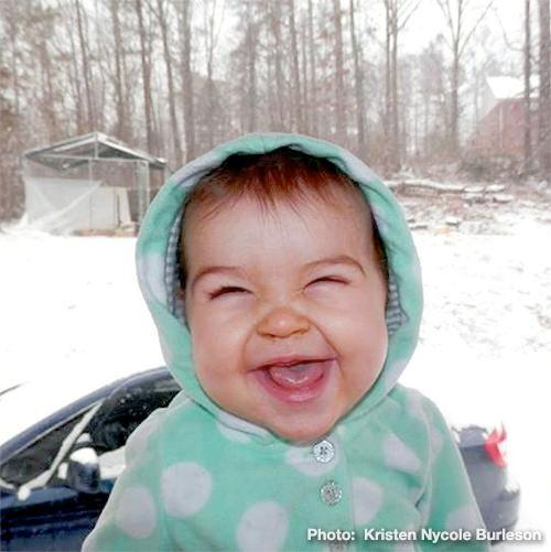 Kaylee, an 8-month-old, is having a blast during her first experience in snow, Tuesday, January 28, 2014.
