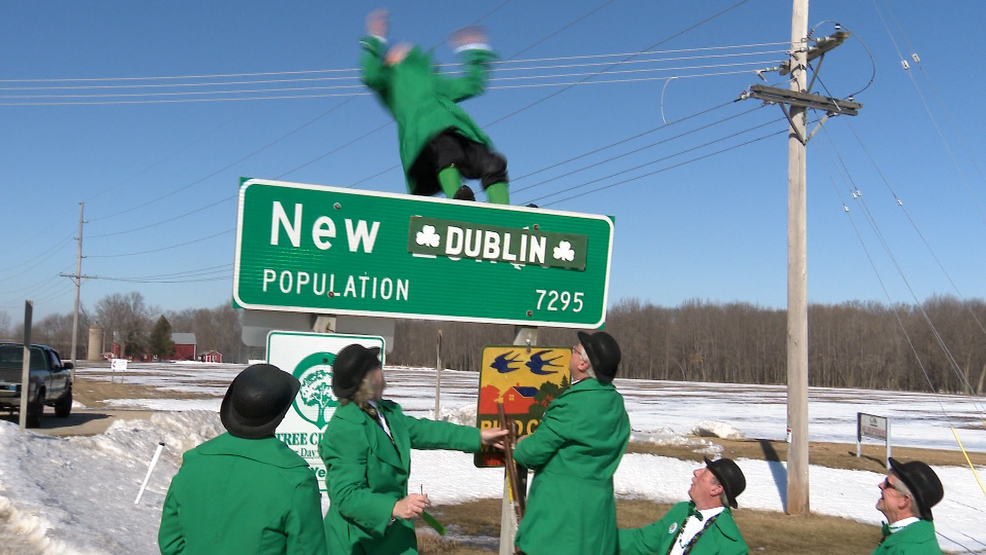"A leprechaun does a backflip after changing a New London welcome sign to read ""New Dublin"" March 18, 2019, in honor of St. Patrick's Day festivities."