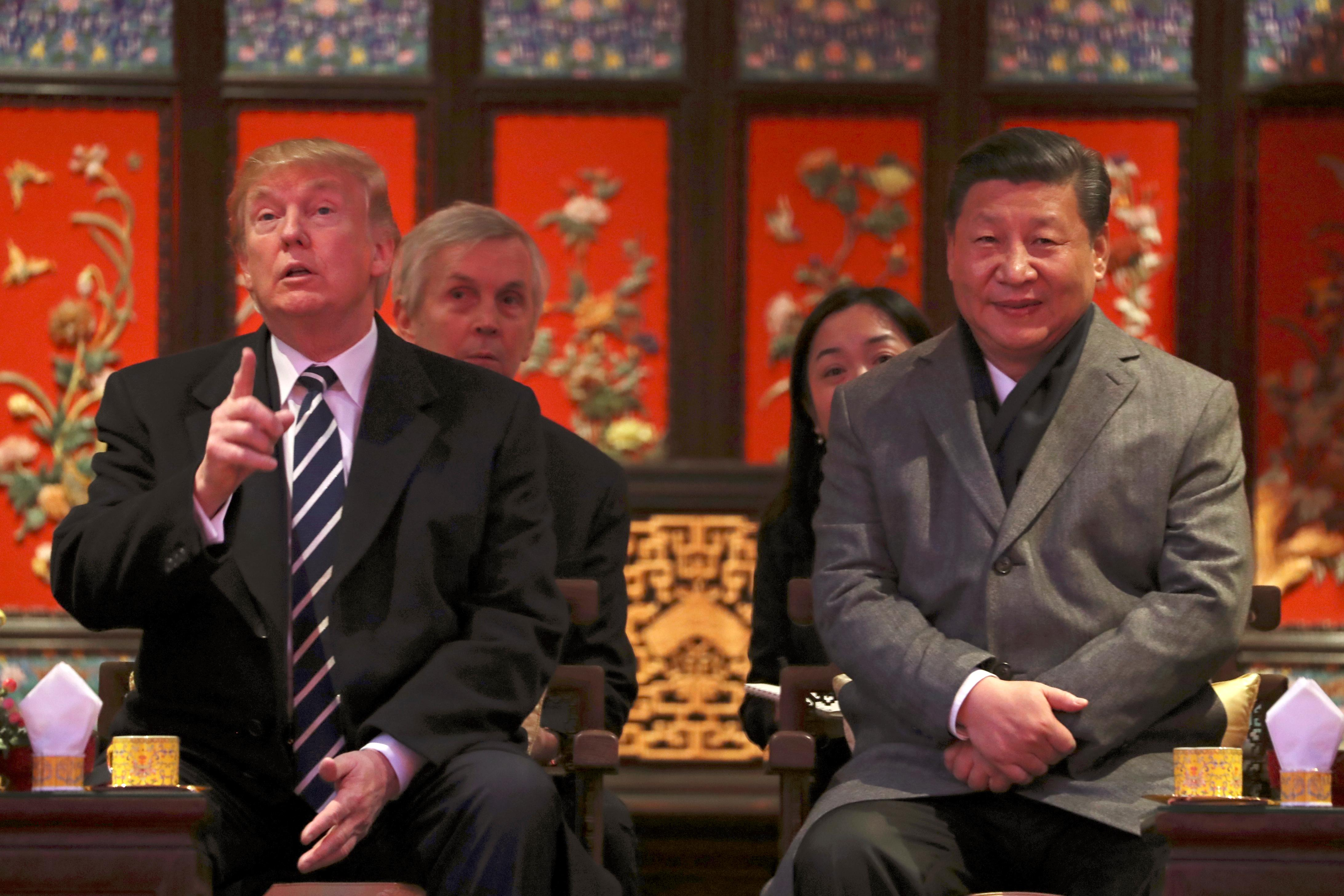 President Donald Trump, left, and Chinese President Xi Jinping, right, arrive for opera performance at the Forbidden City, Wednesday, Nov. 8, 2017, in Beijing, China. Trump is on a five country trip through Asia traveling to Japan, South Korea, China, Vietnam and the Philippines. (AP Photo/Andrew Harnik)