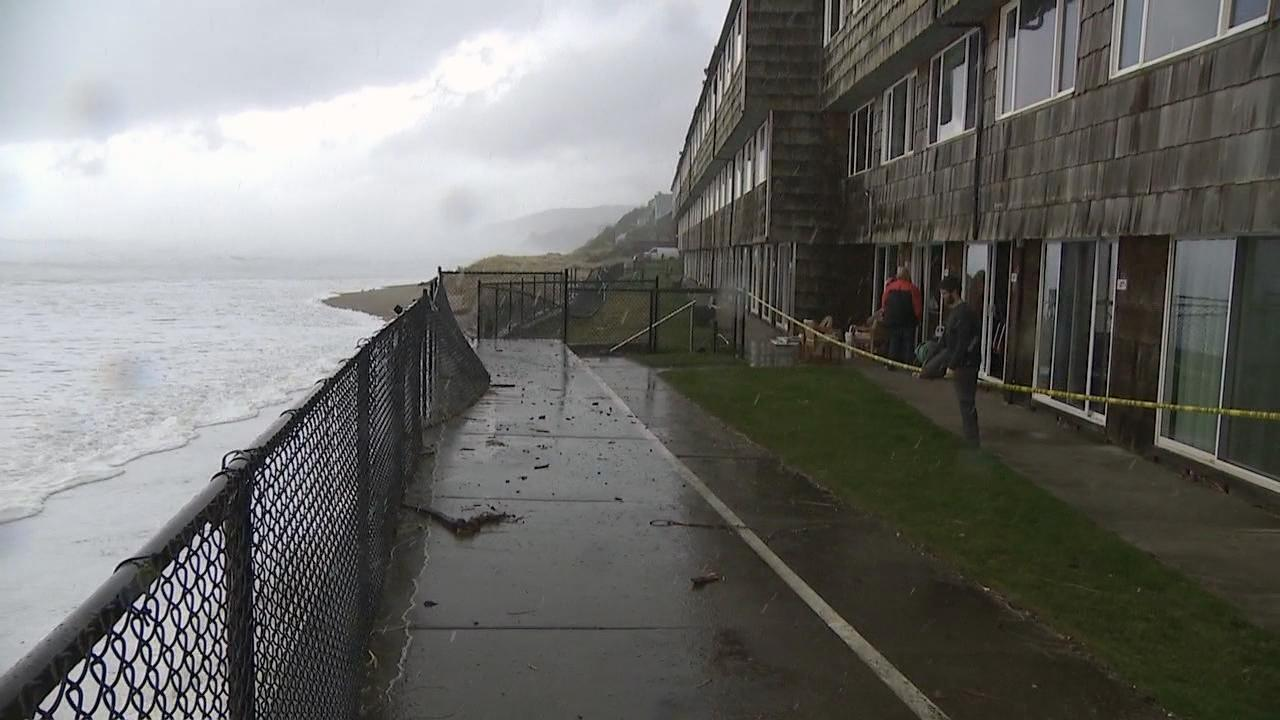 Ocean waves come right up to Sea Gypsy Condominiums in Lincoln City Thursday. At one point they crashed through the windows of two units. (KATU Photo)