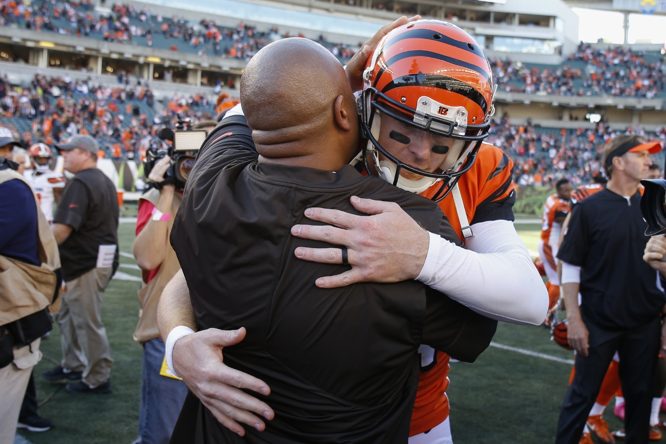 Cincinnati Bengals quarterback Andy Dalton, right, hugs Cleveland Browns head coach Hue Jackson, left, after an NFL football game, Sunday, Oct. 23, 2016, in Cincinnati. (AP Photo/Gary Landers)