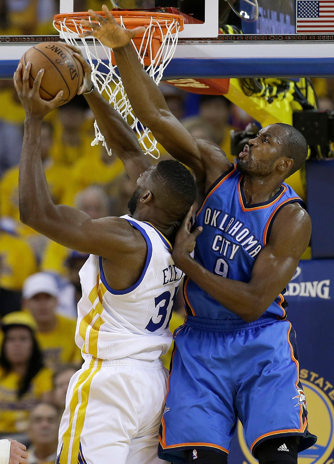 Golden State Warriors center Festus Ezeli (31) shoots against Oklahoma City Thunder forward Serge Ibaka (9) during the first half of Game 2 of the NBA basketball Western Conference finals in Oakland, Calif., Wednesday, May 18, 2016. (AP Photo/Marcio Jose Sanchez)