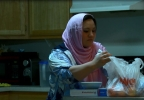 Dilbar Betto, Bashar Karim's wife preparing meals for her family (NTV News).JPG