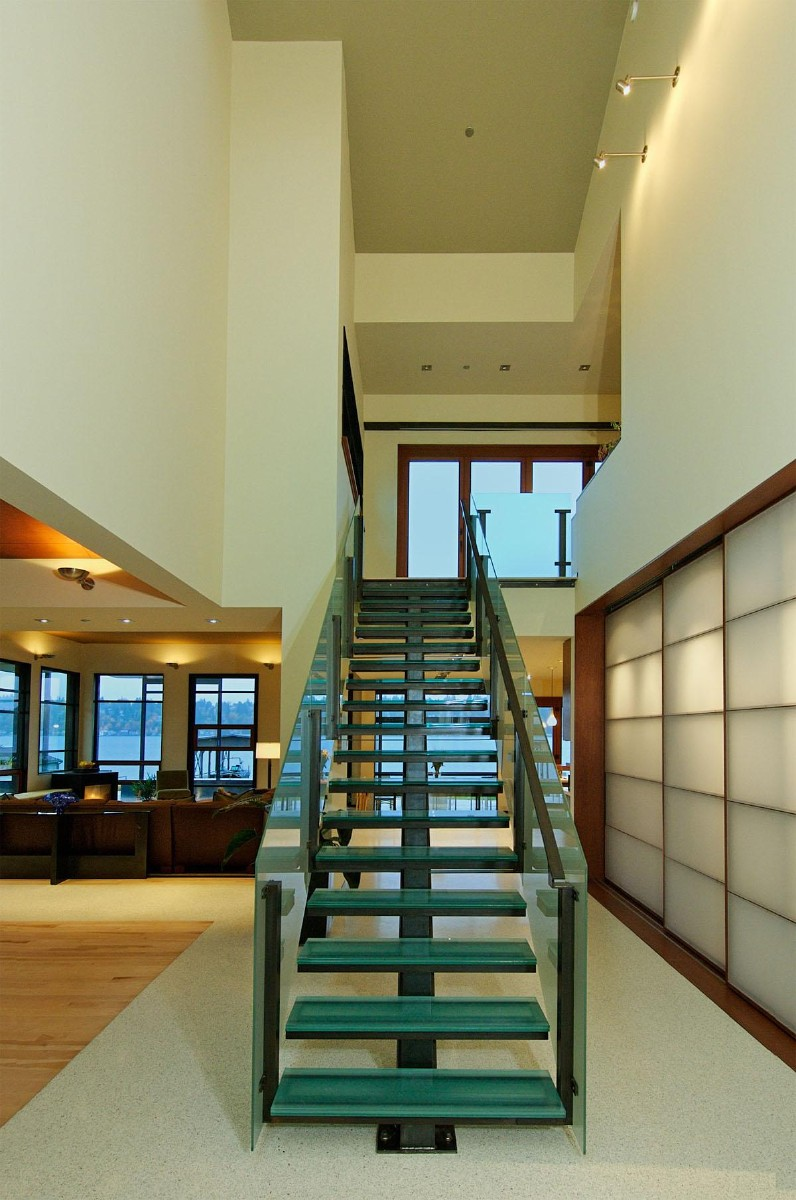 This Kirkland project was completed by Prentiss Architects, and features glass stairs.    (Image: Holmes Point Remodel / Porch.com)