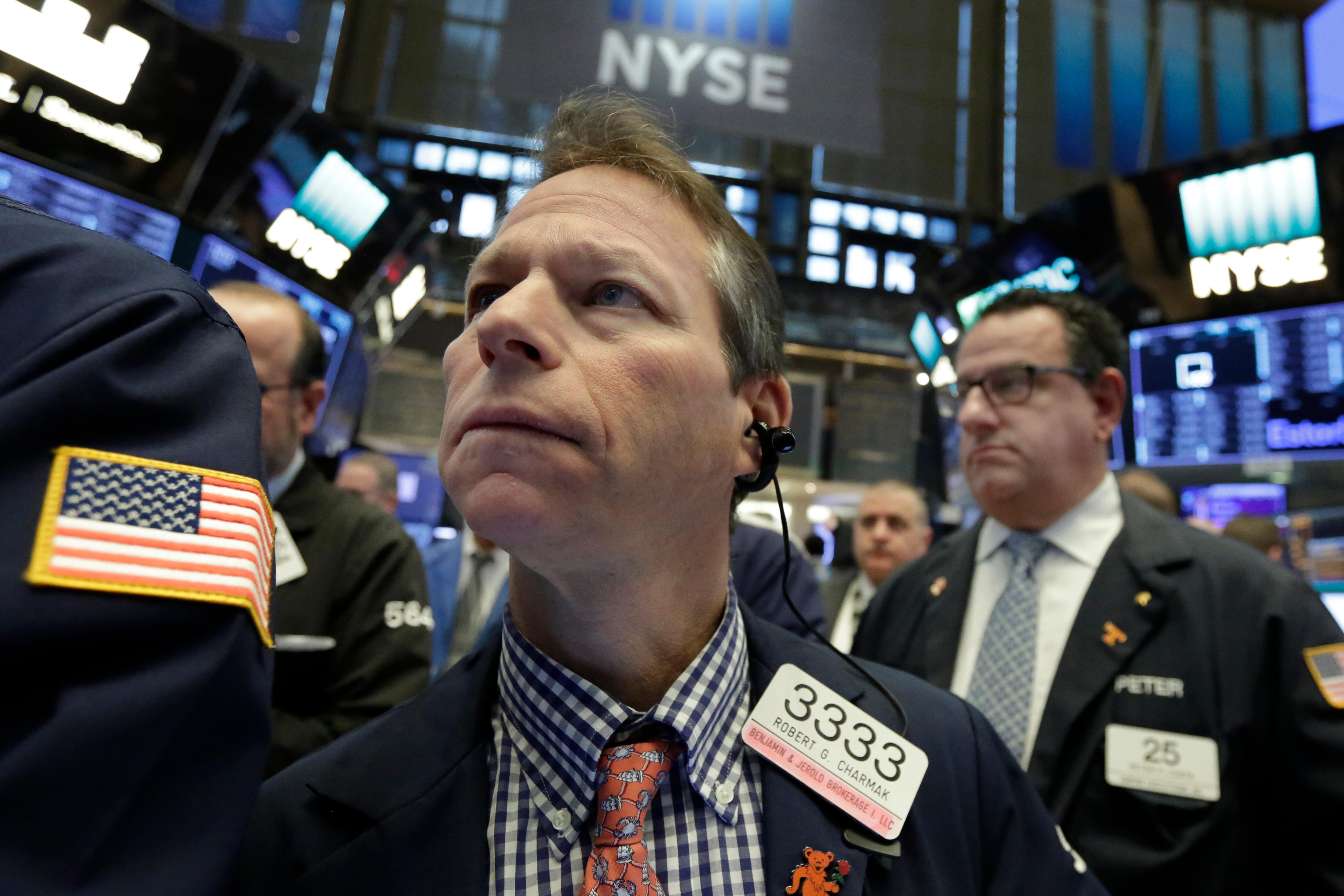 Trader Robert Charmak, center, works on the floor of the New York Stock Exchange, Friday, Feb. 2, 2018. Technology companies were leading stocks broadly lower in early trading, extending the market's slide into a second day. (AP Photo/Richard Drew)
