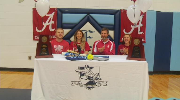 Enka second baseman Kloyee Anderson celebrates at her signing ceremony (WLOS Staff).jpg