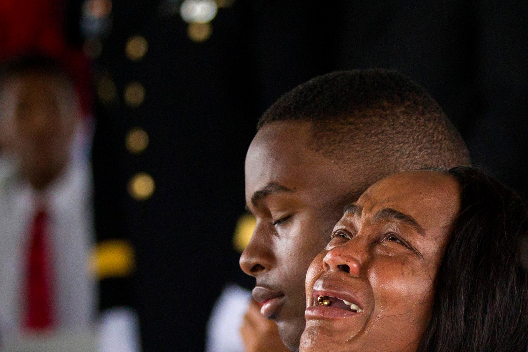 Cowanda Jones-Johnson, right, the aunt of Sgt. La David Johnson, weeps during his burial service at Fred Hunter's Hollywood Memorial Gardens in Hollywood, Fla., on Saturday, Oct. 21, 2017. Johnson was among four soldiers killed in Niger on Oct. 4 when they were attacked by militants tied to the Islamic State.  (Matias J. Ocner/Miami Herald via AP)