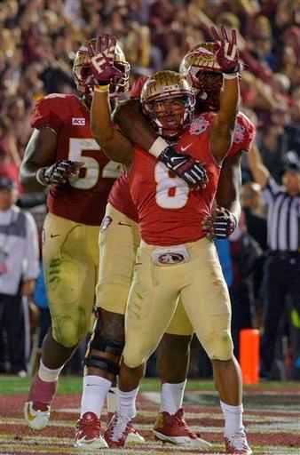 Florida State's Devonta Freeman (8) celebrates his touchdown run during the first half of the NCAA BCS National Championship college football game against Auburn Monday, Jan. 6, 2014, in Pasadena, Calif.