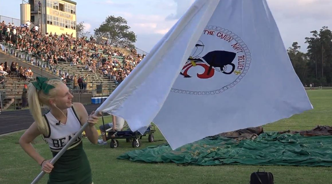 A first responder from the Cajun Navy may feel Texas Strong after a Little Cypress-Maurceville High School cheerleader sketched and painted a flag for him and his team and presented it during homecoming on Friday. Also, other first responders from around Southeast Texas were also honored and thanked for their heroic efforts during the storm.