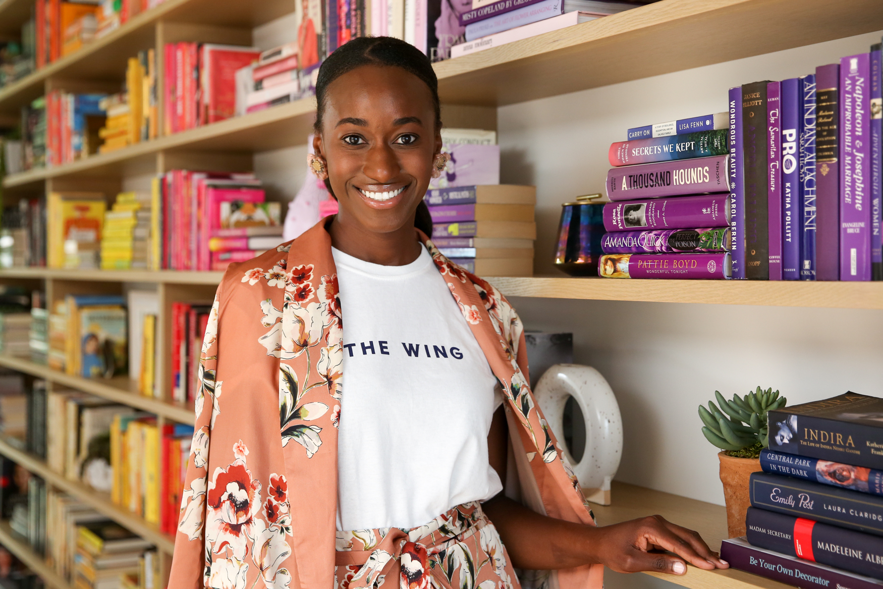 "Shayla Alexander works at The Wing's front desk and helps with its events. She says the best thing about working at The Wing is the positive vibes. ""I actually work full time somewhere else,"" she explained, ""but when I'm in (The Wing's) space, it's just immediate zen, support and empowerment. It's just a great space to be in.""{ } (Amanda Andrade-Rhoades/DC Refined)"
