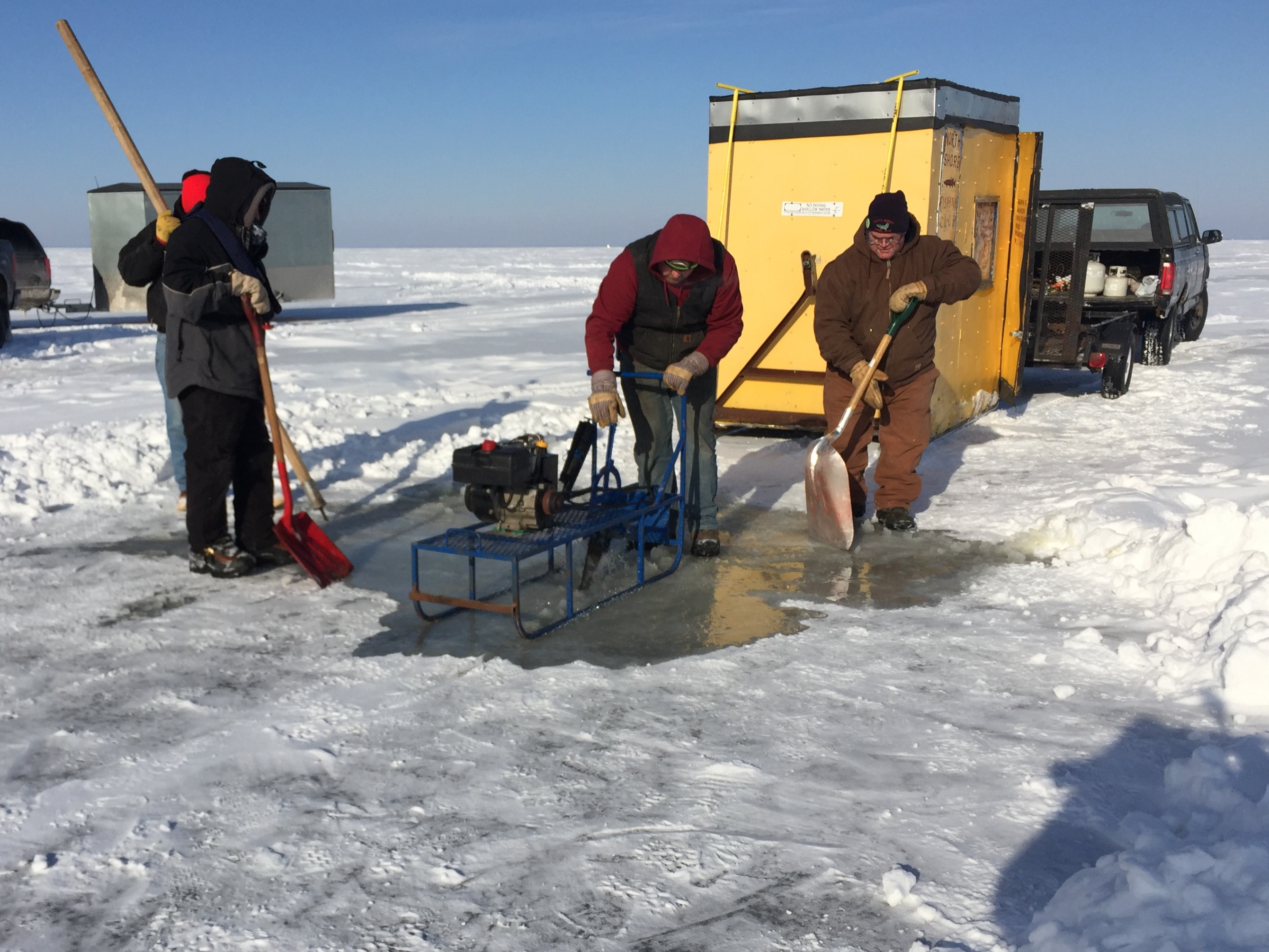 Ice cutting using a sled saw on Lake Winnebago near Quinney, February 8, 2018 (WLUK/Eric Peterson)