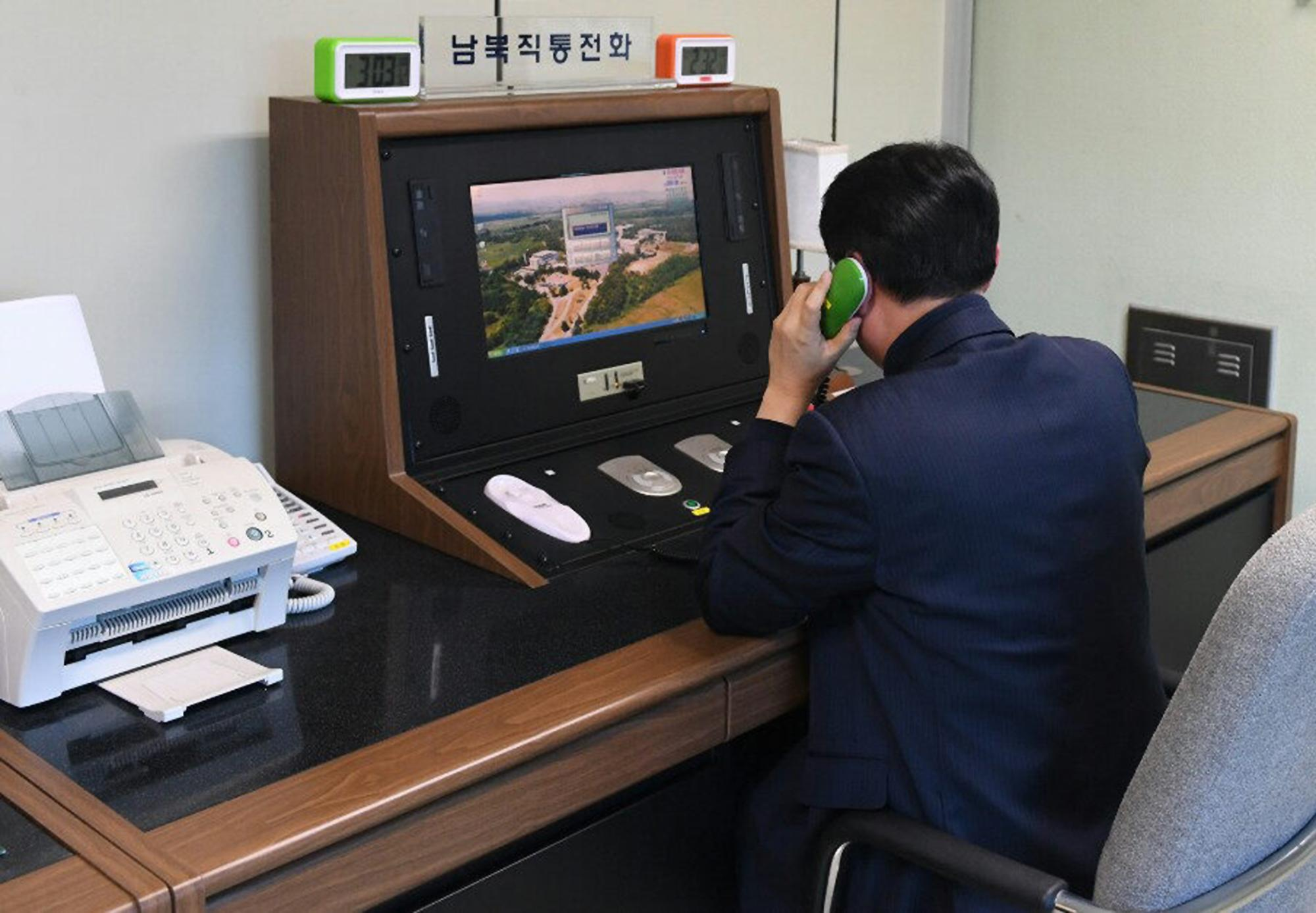 A South Korean government official checks the direct communications hotline to talk with the North Korean side at the border village of Panmunjom in Paju, South Korea, Wednesday, Jan. 3, 2018.{&amp;nbsp;} (Yonhap via AP)<p></p>