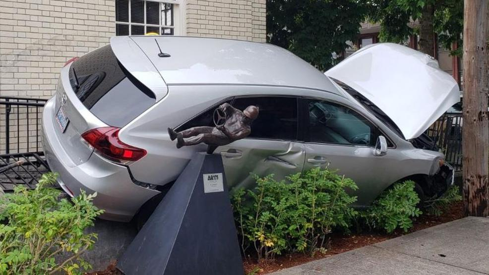 Driver' statue nearly taken out by Minivan at Puyallup post