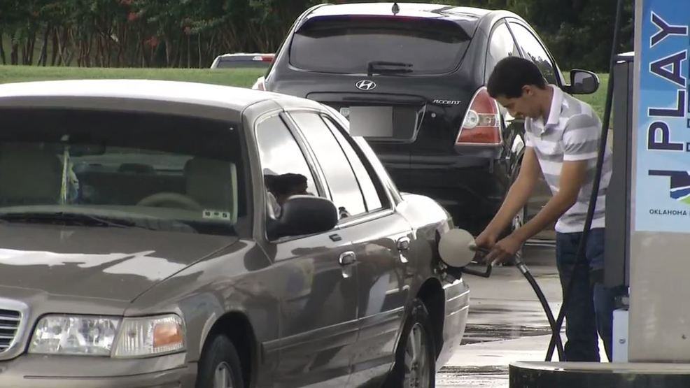 A man is filling is car with gas. (File KOKH).JPG