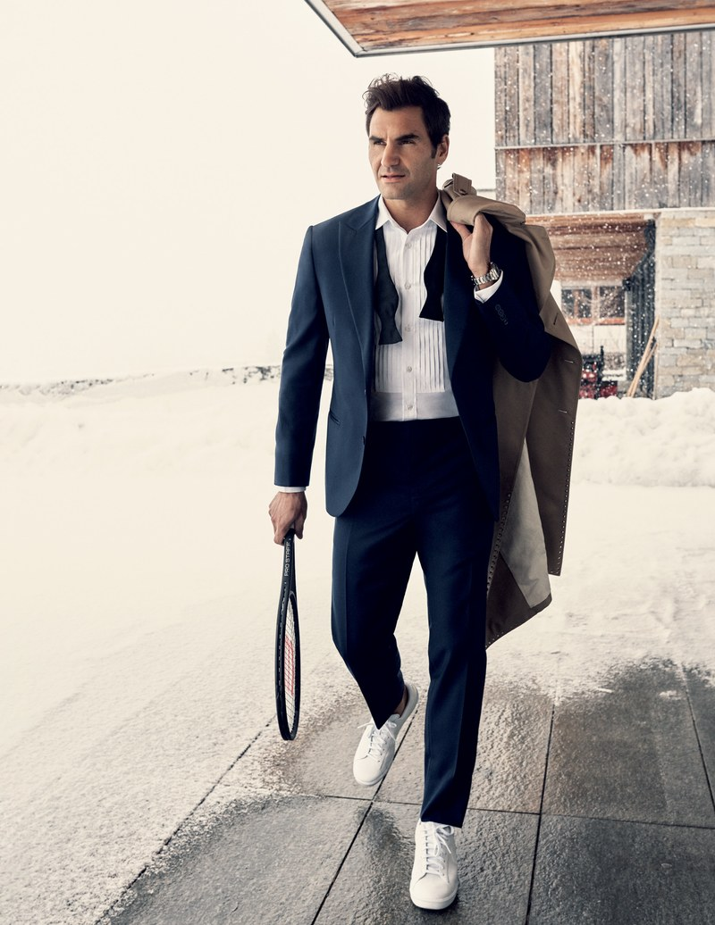 Photo Source: GQ Magazine                   Tuxedo, $4,495, Brunello Cucinelli + shirt $875 Brunello Cucinelli / Bow tie, $60, by Brooks Brothers / Trench coat, $2,950, by Valentino / Sneakers, $100, by Nike / Watch by Rolex / Racket by Wilson Sporting Goods Co.DALiM