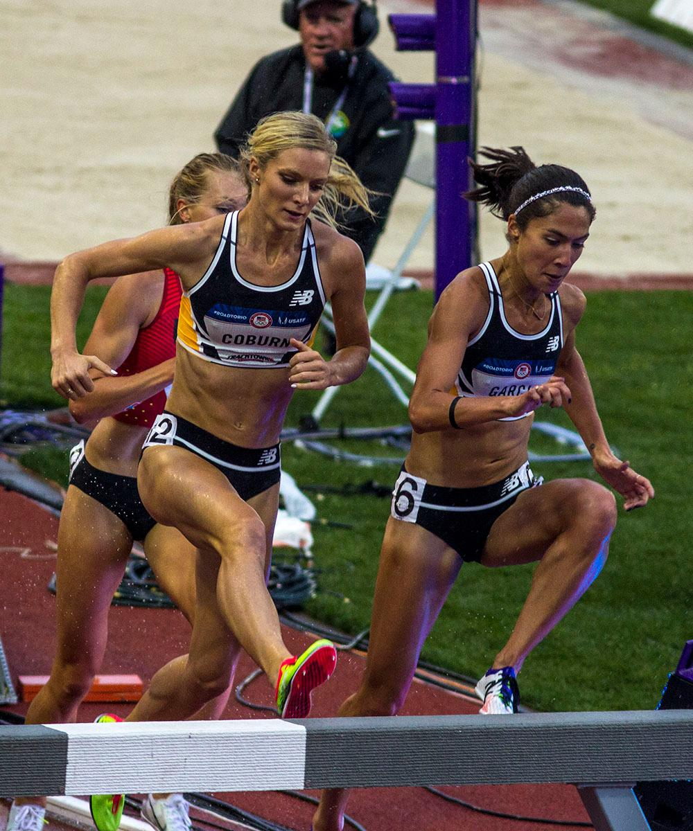 Emma Coburn, left, and Stephanie Garcia, right, leap over a hurdle in the Women's 3000m Steeplechase final. Coburn finished first with a time of 9:17.48 and Garcia finished fifth with a time of 9:28.99. Day seven of the U.S. Olympic Track and Field Trial took place Thursday at Hayward Field in Eugene, Ore. Events continue through July 10. (Photo by Amanda Butt)