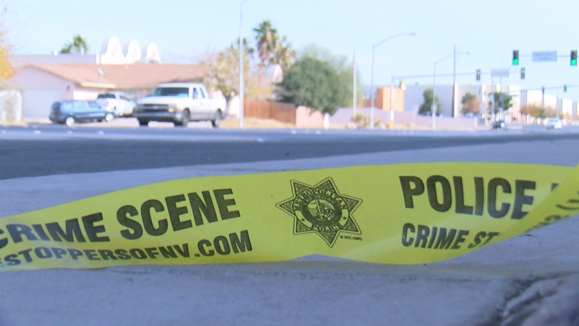 A man was shot and killed after trying to break into a car with a family inside on New Year's Eve near Alexander and Lamb. (KSNV)