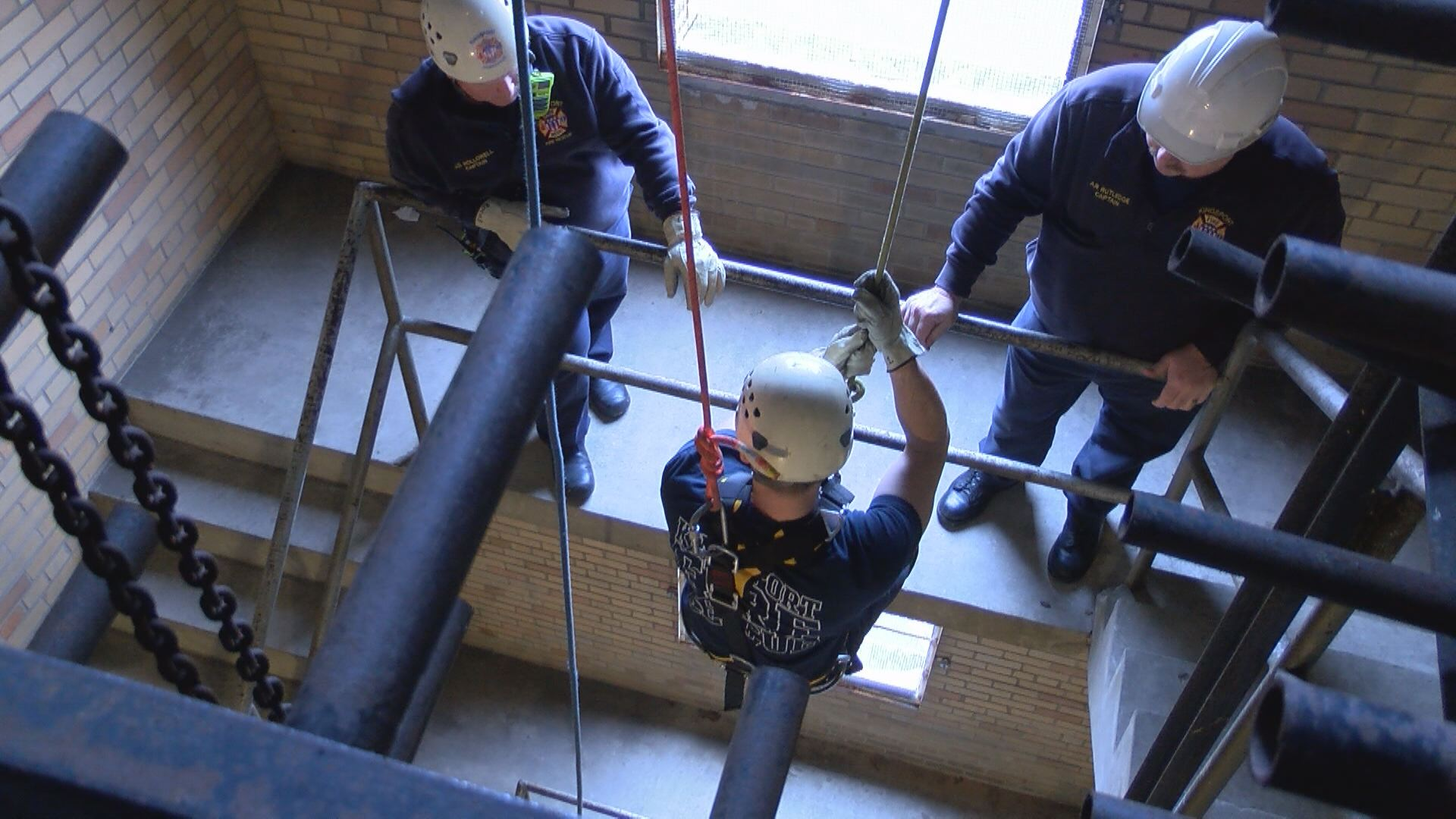 Rookie Zach Helvey gets lowered on the ropes for the first time. Helvey said he hopes someday to join the technical rescue team. (Thomas Gray/WCYB)