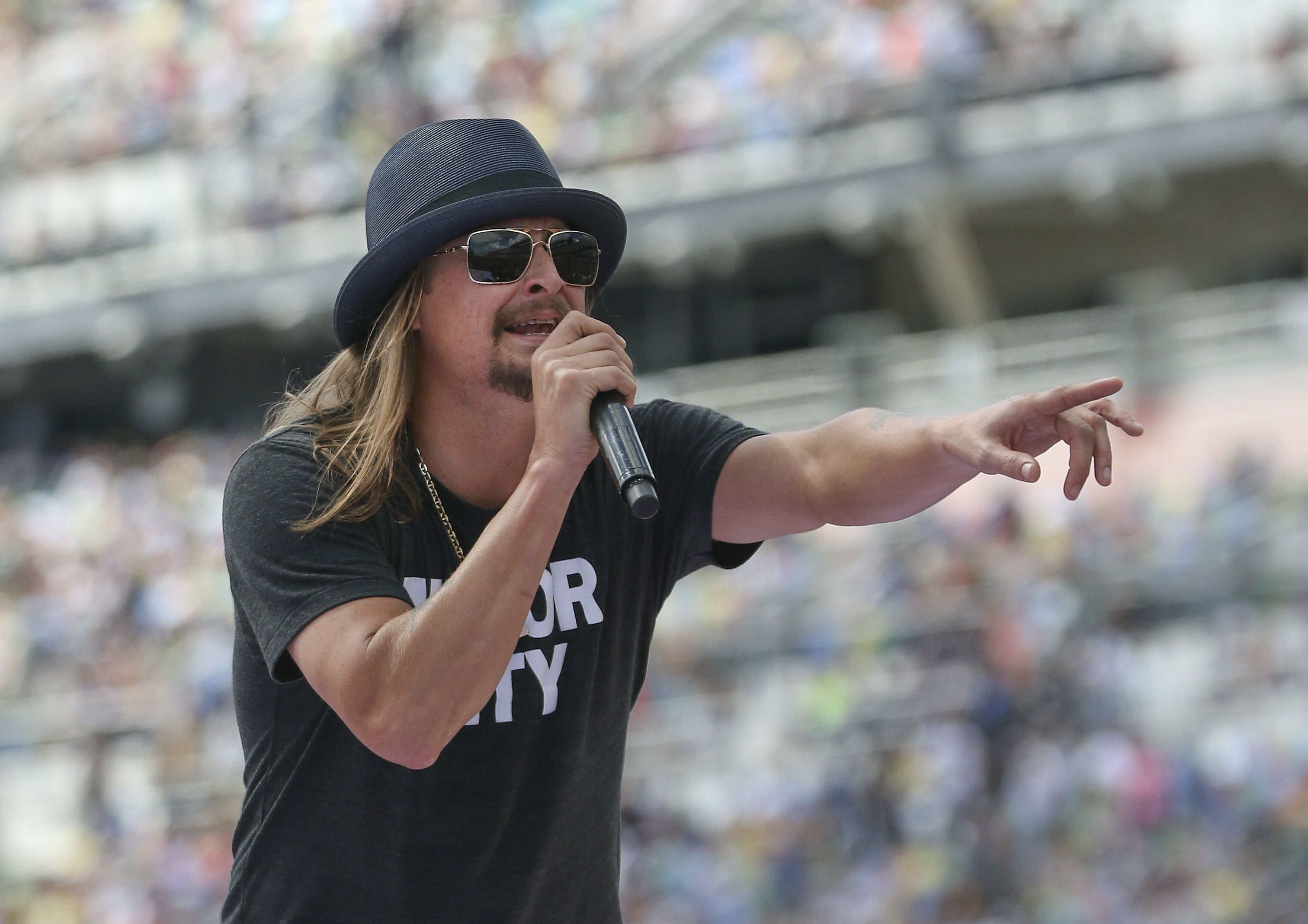 In this photo taken Feb. 22, 2015, singer Kid Rock performs a concert before the Daytona 500 auto race in Daytona Beach, Fla.  (AP Photo/Reinhold Matay)