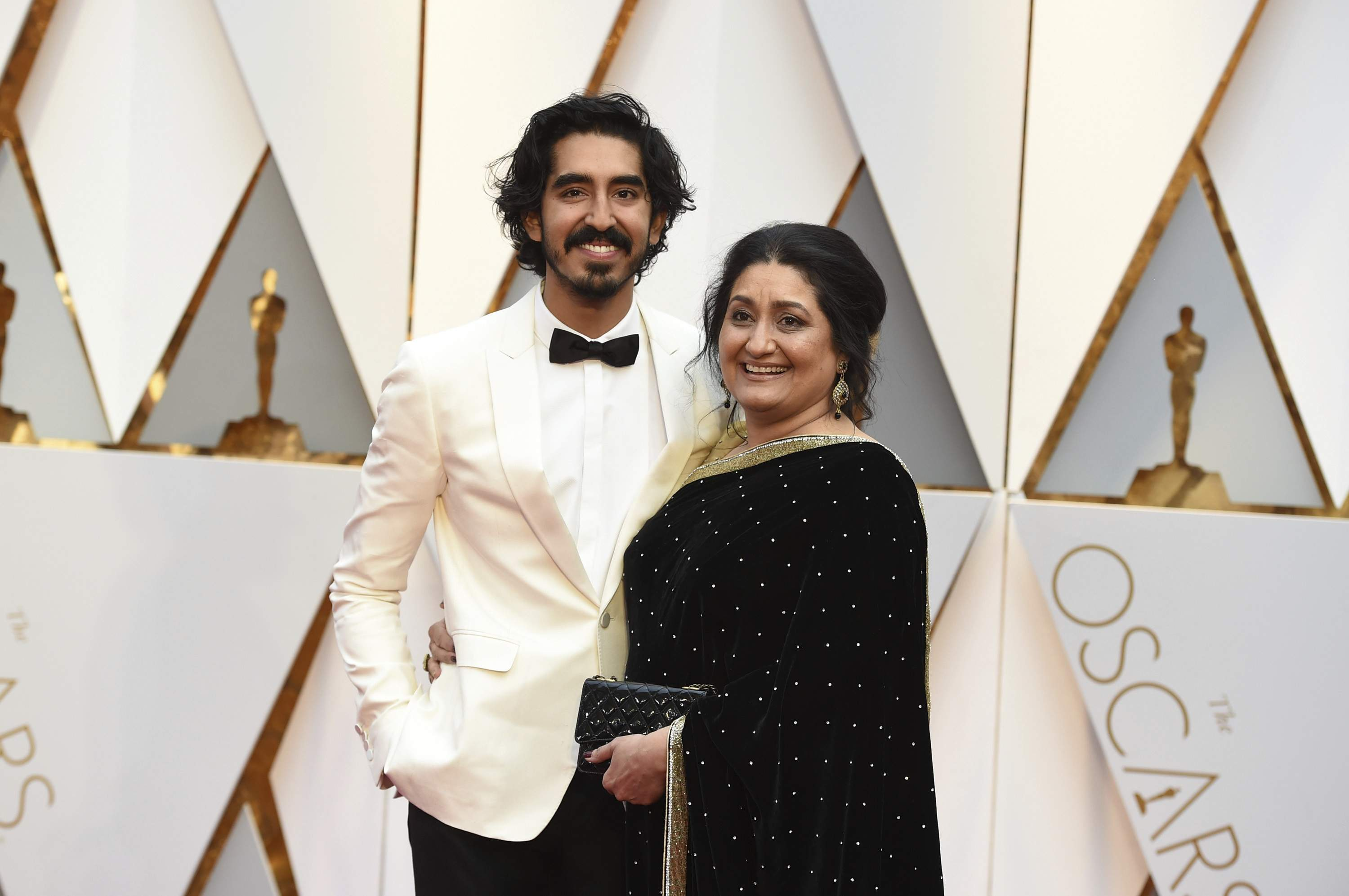 Dev Patel, left, and Anita Patel arrive at the Oscars on Sunday, Feb. 26, 2017, at the Dolby Theatre in Los Angeles. THE ASSOCIATED PRESS