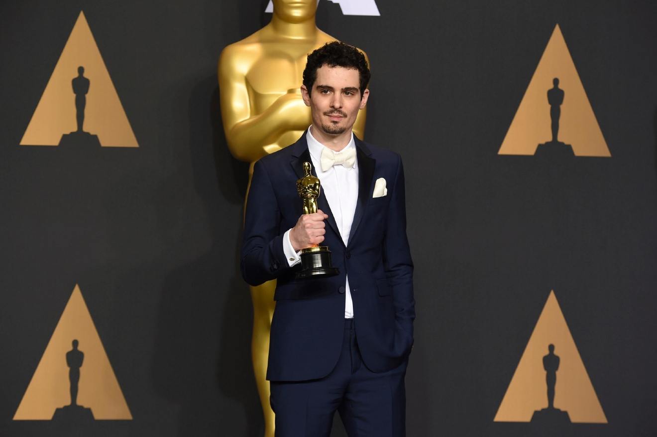 "Damien Chazelle poses in the press room with the award for best director for ""La La Land"" at the Oscars on Sunday, Feb. 26, 2017, at the Dolby Theatre in Los Angeles. (Photo by Jordan Strauss/Invision/AP)"