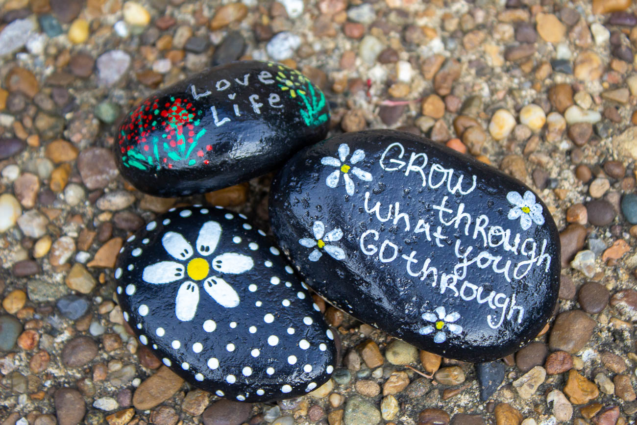 The NKY Hidden Rocks Facebook page started in 2017 by founder Jo Price Craven to combat negativity she was seeing online. The concept is to design a rock with inspiring words or images, hide it in the community, and brighten someone's day when they find it. They can then keep the rock, re-hide it, or replace it with one of their own to keep the positive, traveling rocks in circulation. / Image: Katie Robinson, Cincinnati Refined // Published: 8.17.19