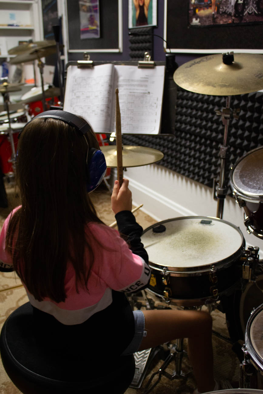 Greg Slone, Christie's boyfriend, teaches the drum lessons called Drum Power in the studio. / Image: Katie Robinson, Cincinnati Refined // Published: 9.22.19