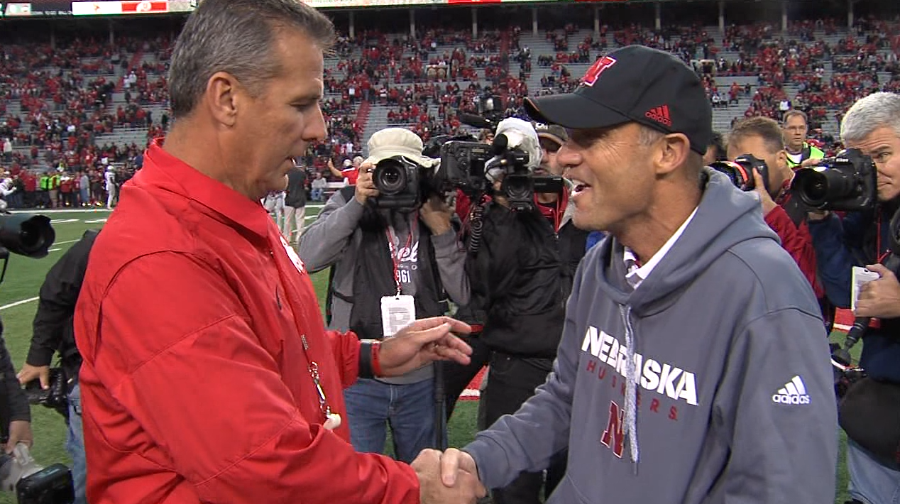 Mike Riley and Urban Meyer greet each other during pre-game warm-ups when Ohio State visited Lincoln.{&amp;nbsp;}<p></p>