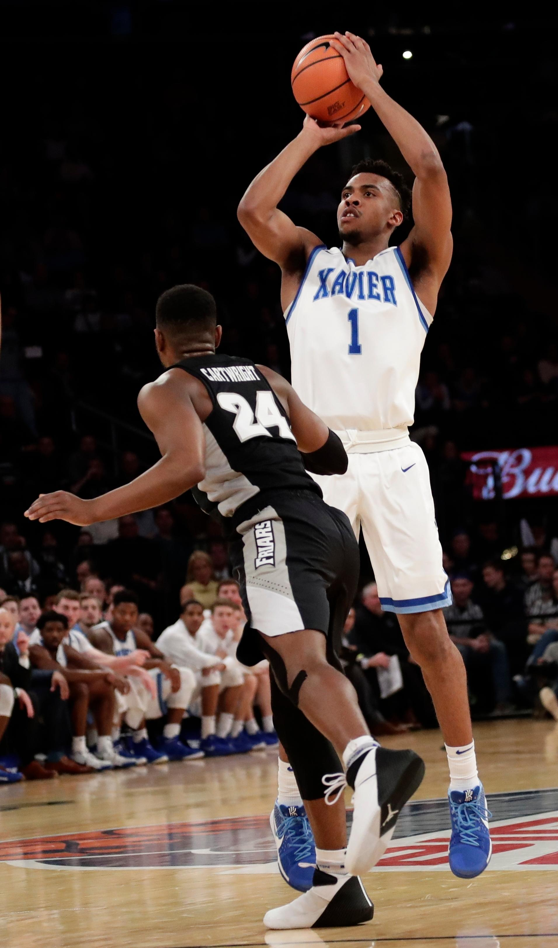 Xavier's Paul Scruggs (1) shoots over Providence's Kyron Cartwright (24) during the first half of an NCAA college basketball game in the Big East men's tournament semifinals Friday, March 9, 2018, in New York. (AP Photo/Frank Franklin II)