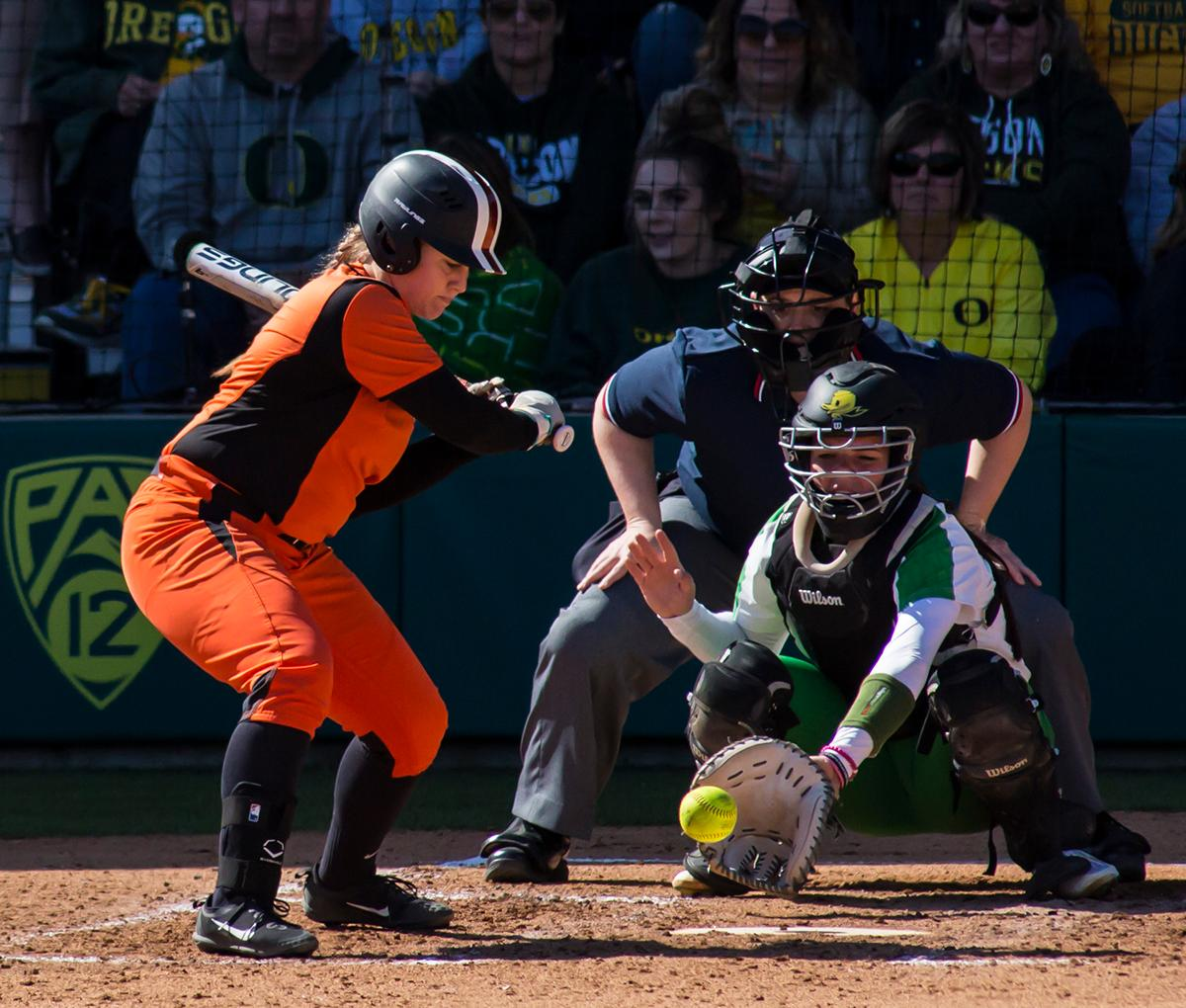 Oregon State in-fielder Alyssa Everett (#5) watches a pitch fly into the mitt of Oregon Catcher Gwen Svekis (#21). The Oregon Ducks defeated the Oregon State Beavers seven to zero on Sunday, April 30, 2017. The Ducks' victory marked the third victory of the three game sweep against the Beavers. Photo by Ben Lonergan, Oregon News Lab