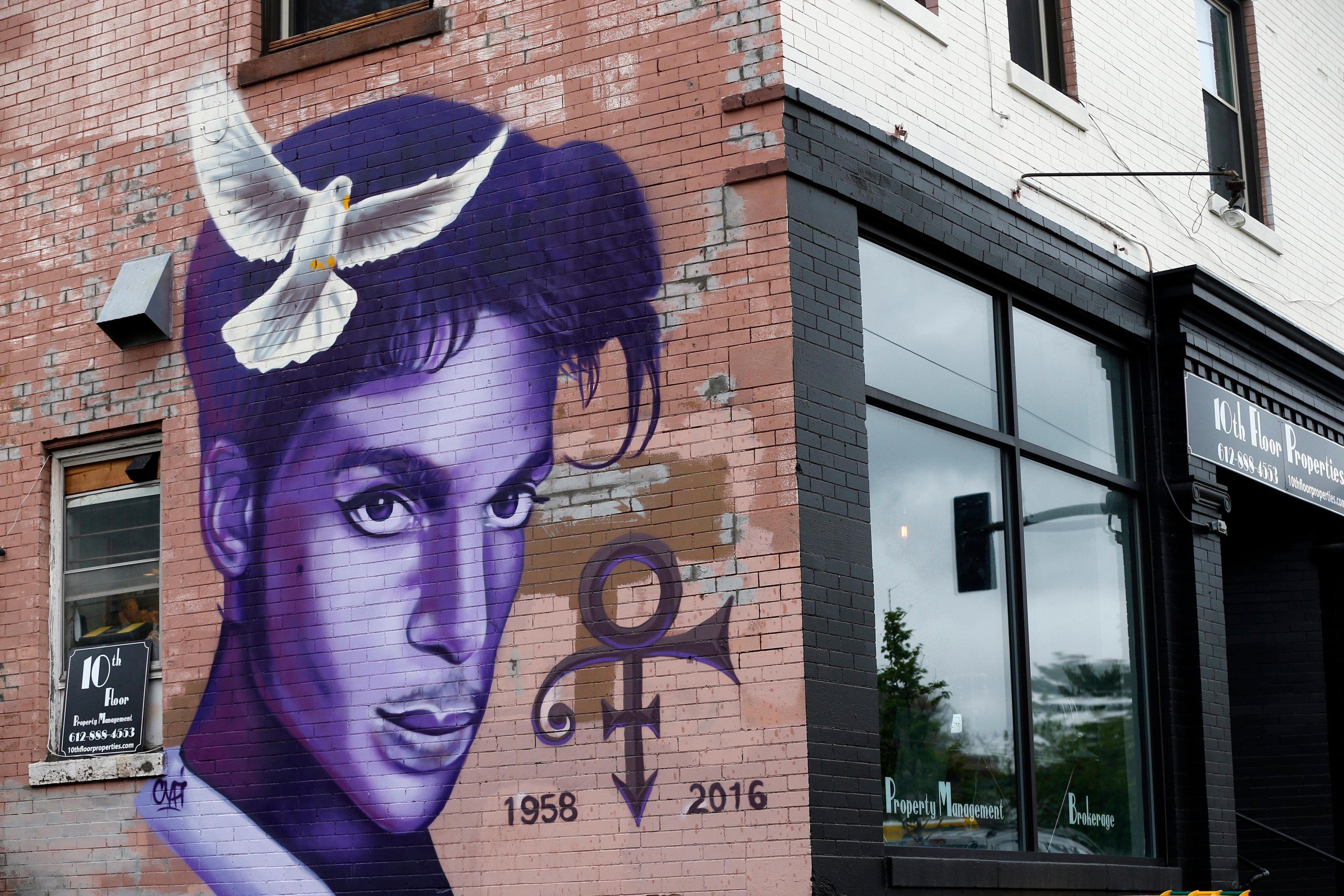 "FILE - In this Aug 28, 2016, file photo, a mural honoring the late Prince adorns a building in the Uptown area of Minneapolis. In addition, at his home and recording studio-turned-museum, a full four days of events are on tap for the one-year anniversary of his death on April 21, 2016, ranging from concert performances by the great one's former band mates to panel discussions on his legacy. Fans who can't afford those high-dollar tickets can head to a street party outside the club he made famous in ""Purple Rain."" (AP Photo/Jim Mone, File)"
