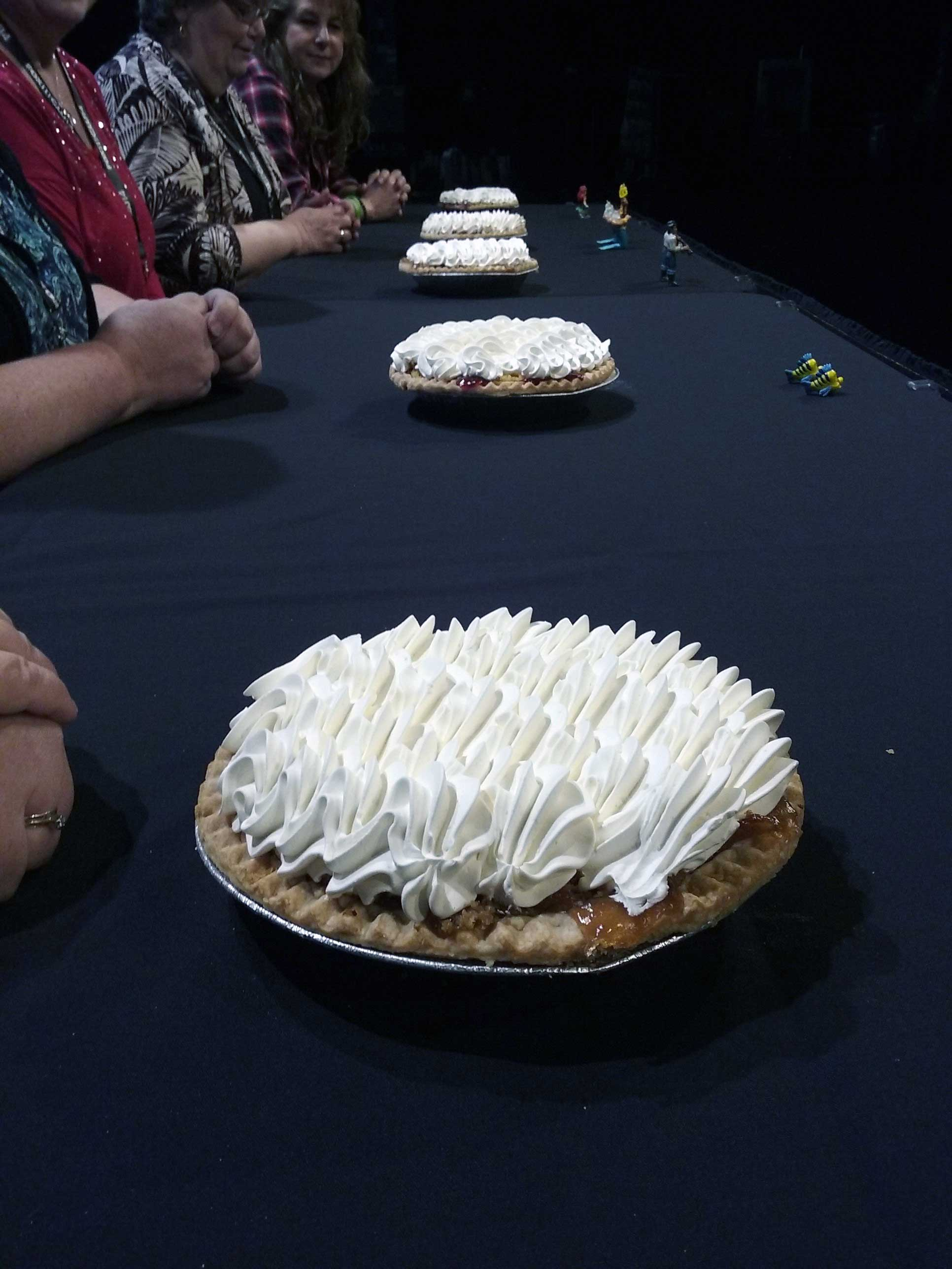 Pies sit on a table April 13, 2017, at the Fox Cities Performing Arts Center in Appleton. One of the pies contains the winning ticket for the Good Day Wisconsin Broadway Nights contest hidden inside. (WLUK/Kimberly Krejcarek)