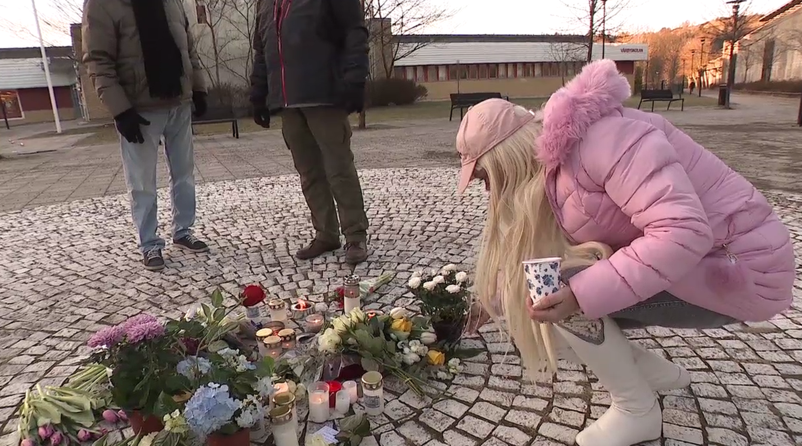 In a residential neighborhood, a man was killed on a Sunday morning after picking up an explosive device that sat outside a train station in Vårby gård. A memorial stood in his honor Monday. (Sinclair Broadcast Group)<p></p>