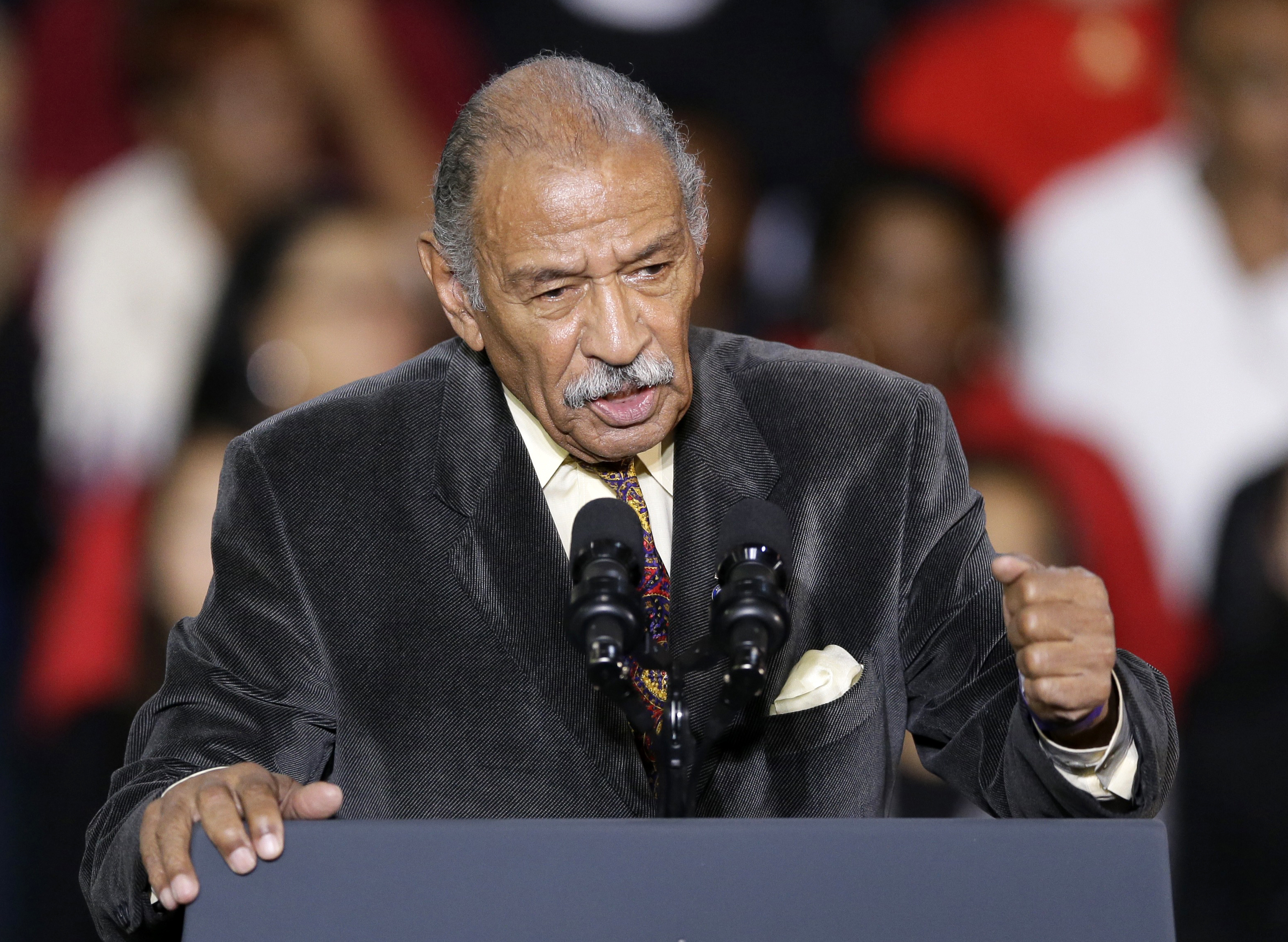 "FILE - In this Nov. 1, 2014, file photo, Rep. John Conyers, D-Mich., speaks at Wayne State University in Detroit. Democrats have been quick to support the ""me too"" chorus of women _ and some men _ who have stepped up to allege sexual misconduct and name names. But now ""me too"" stains the Democrats, too, putting them in an awkward place as they calibrate how forcefully to respond. (AP Photo/Carlos Osorio, F"