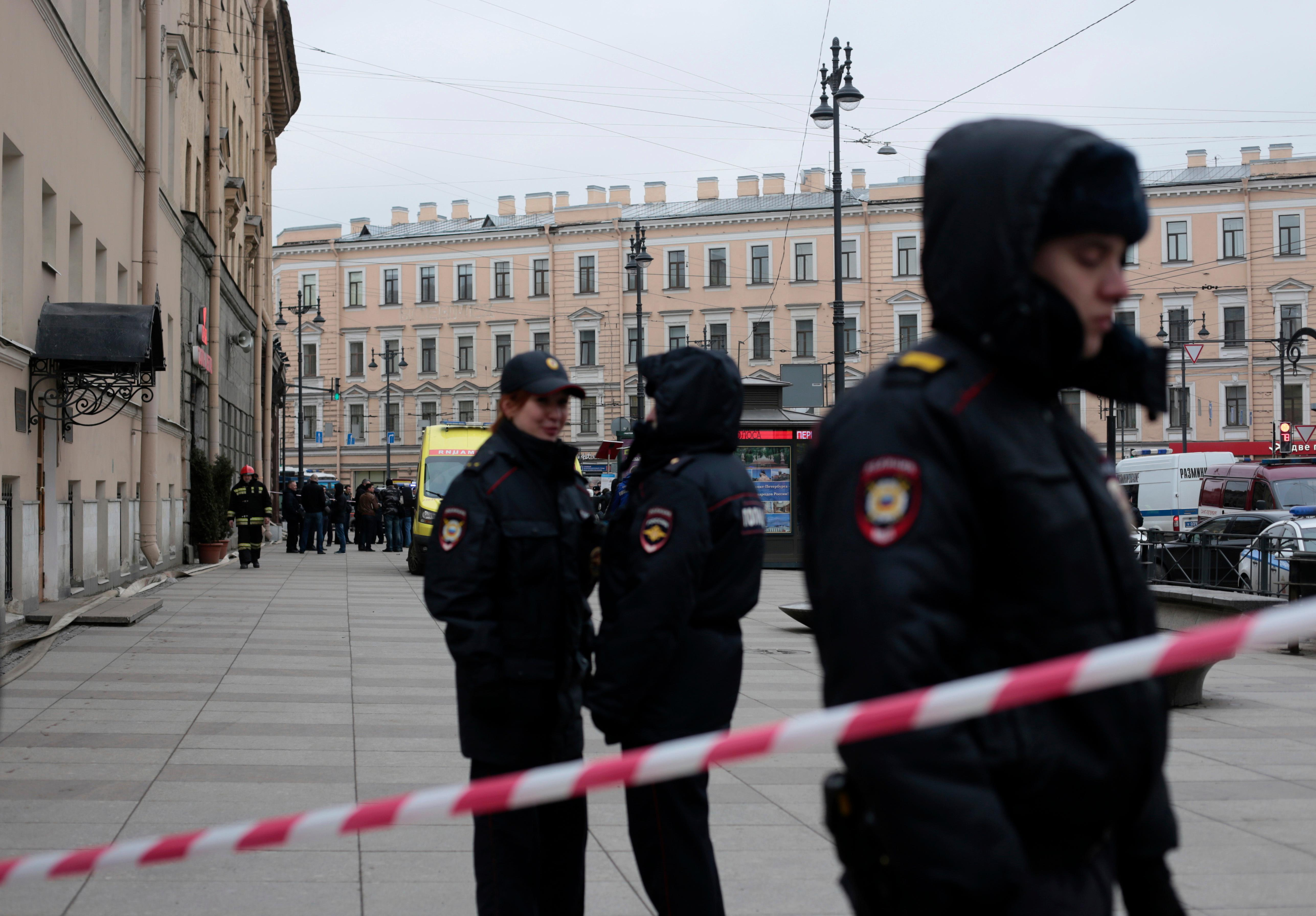 Russian police officers stand guard in a street after an explosion in St. Petersburg's subway, Russia, Monday, April 3, 2017. (AP Photo/Evgenii Kurskov)