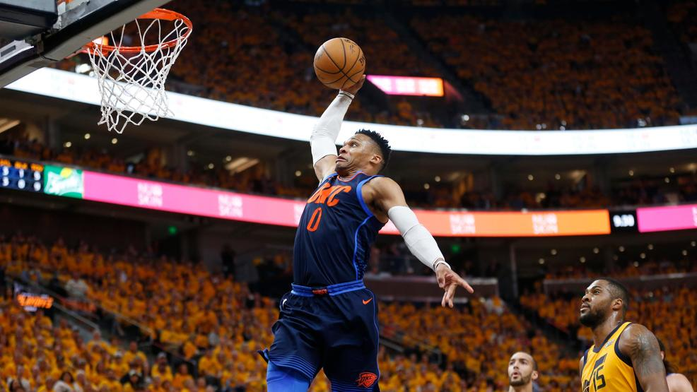 Oklahoma City Thunder guard Russell Westbrook goes up for a dunk as Utah  Jazzs Rudy Gobert (27) and Derrick Favors (15) watch during the first half  of Game ...