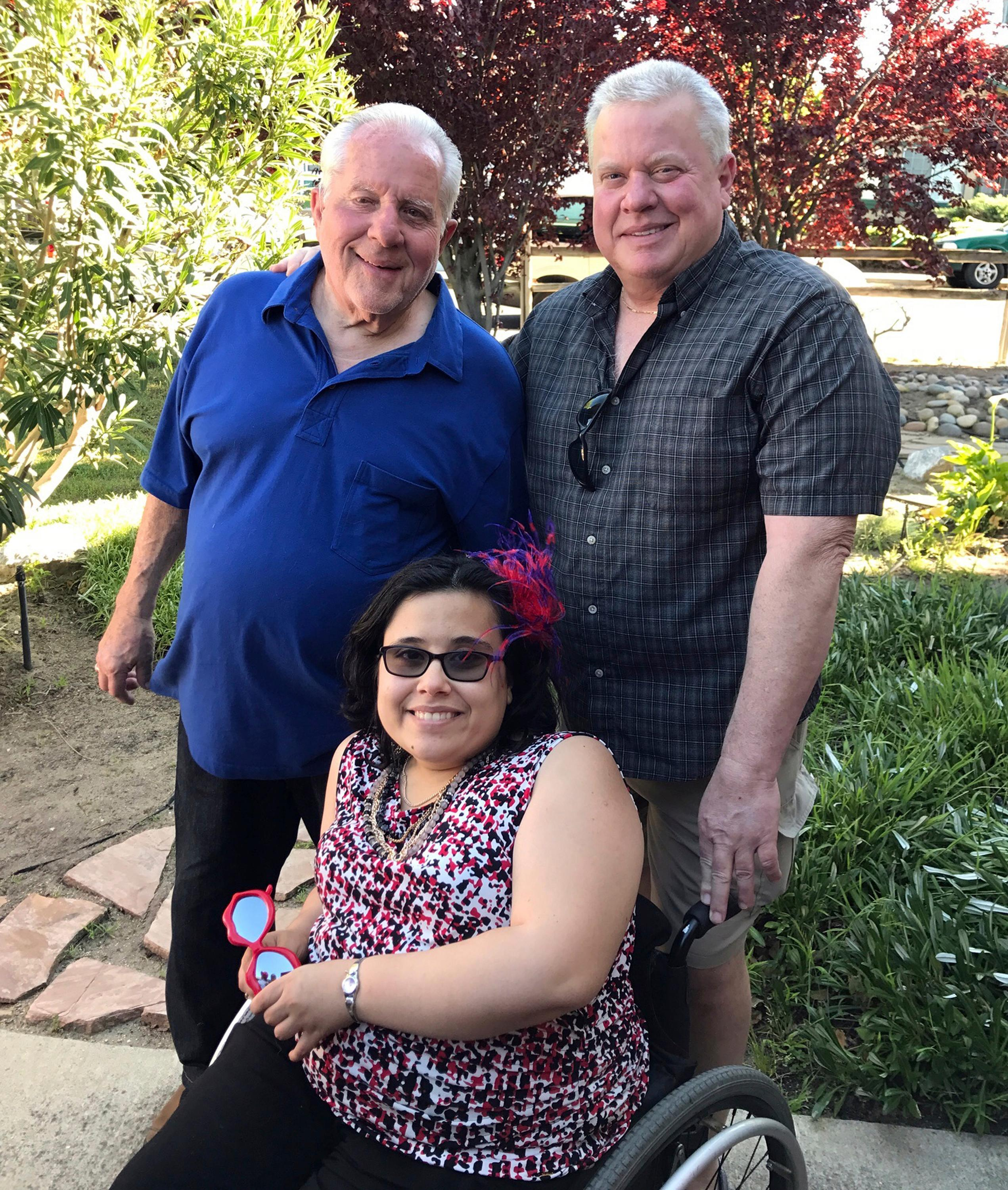 This April, 2017 photo by Brittney Vinculado shows Christina Hanson, with her grandfather Dick Hanson, left, and her father Michael Hanson, in Oakley, Calif. Christina Hanson, 27, used a wheelchair and spent her life dedicated to helping others despite her own hardships, her family said. Kelsi Mannhalter had posted on social media asking people to search for her cousin after the fire Monday ravaged Santa Rosa where Hanson lived. Mannhalter later confirmed on Facebook that Hanson did not survive when the flames consumed her home. (Brittney Vinculado via AP)