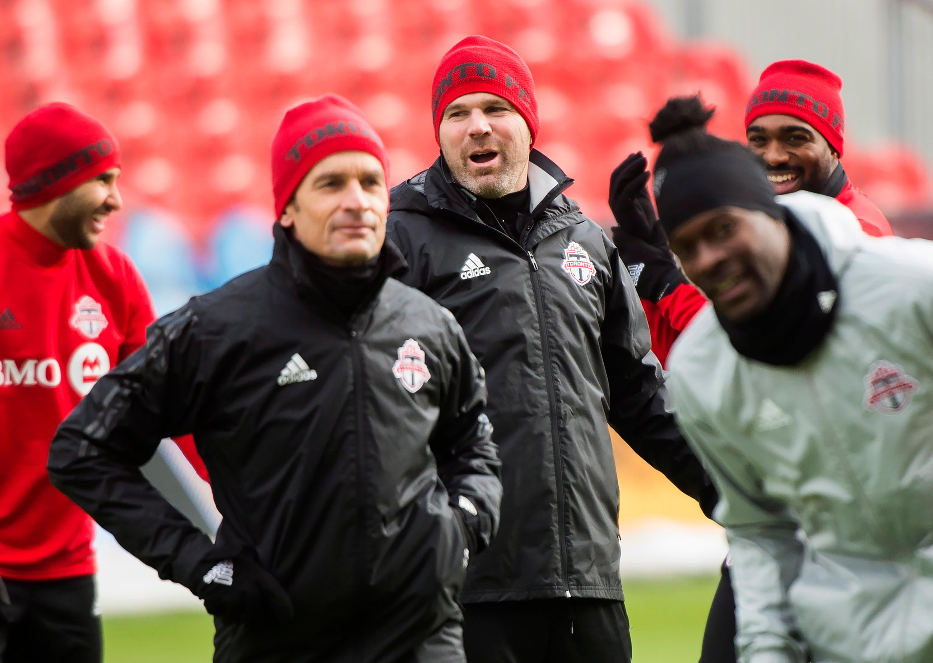 Toronto FC head coach Greg Vanney, center, jokes around during practice ahead of the MLS Cup soccer final against the Seattle Sounders, in Toronto, Friday, Dec. 8, 2017. (Nathan Denette/The Canadian Press via AP)