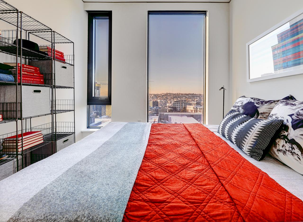 A bedroom in a two bedroom apartment at AMLI Arc