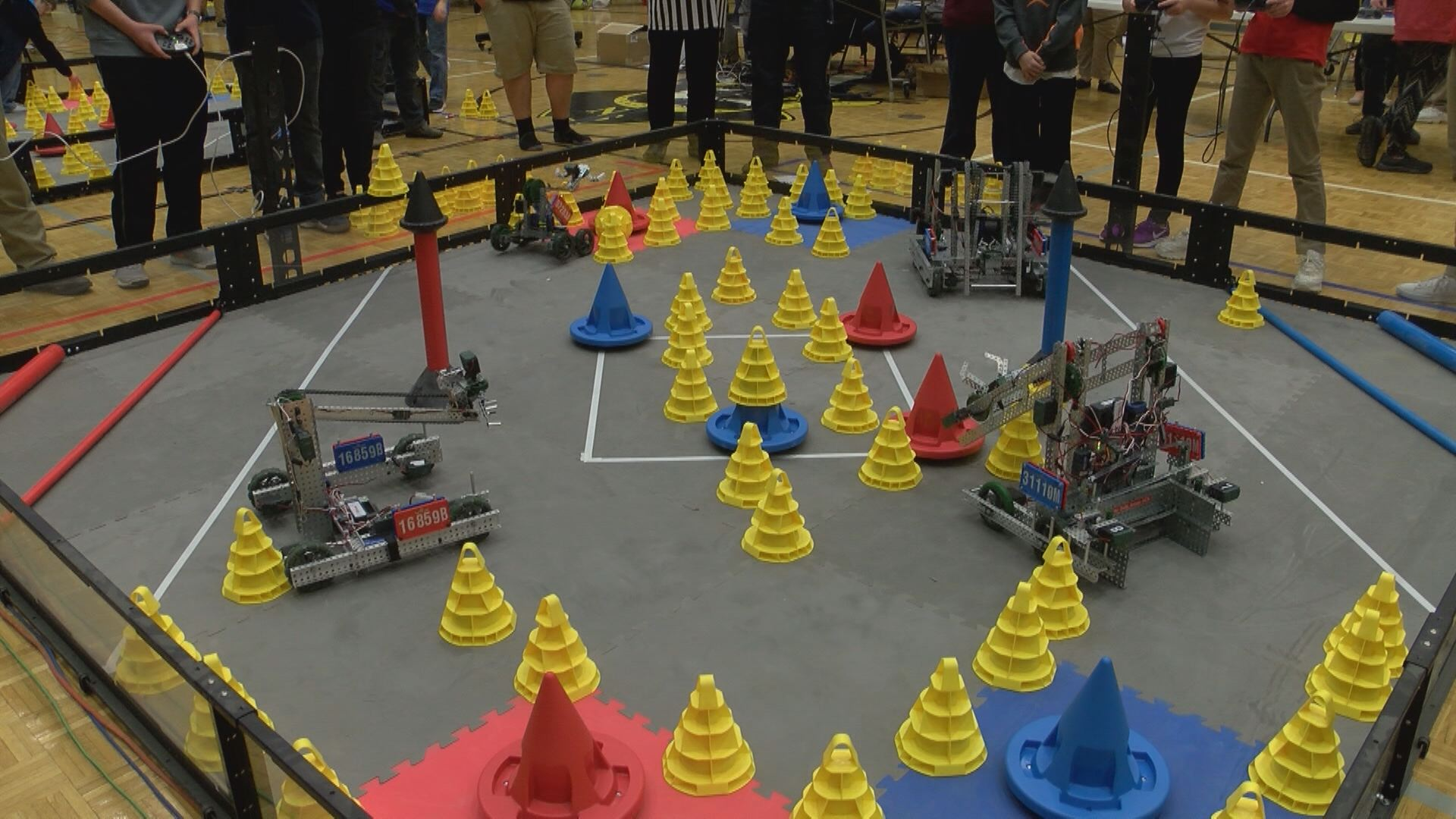 Points are scored by stacking yellow cones on top of the red and blue goals, or by moving the shorter mobile goals into the scoring zones at the corners of the match area. (Thomas Gray/WCYB)