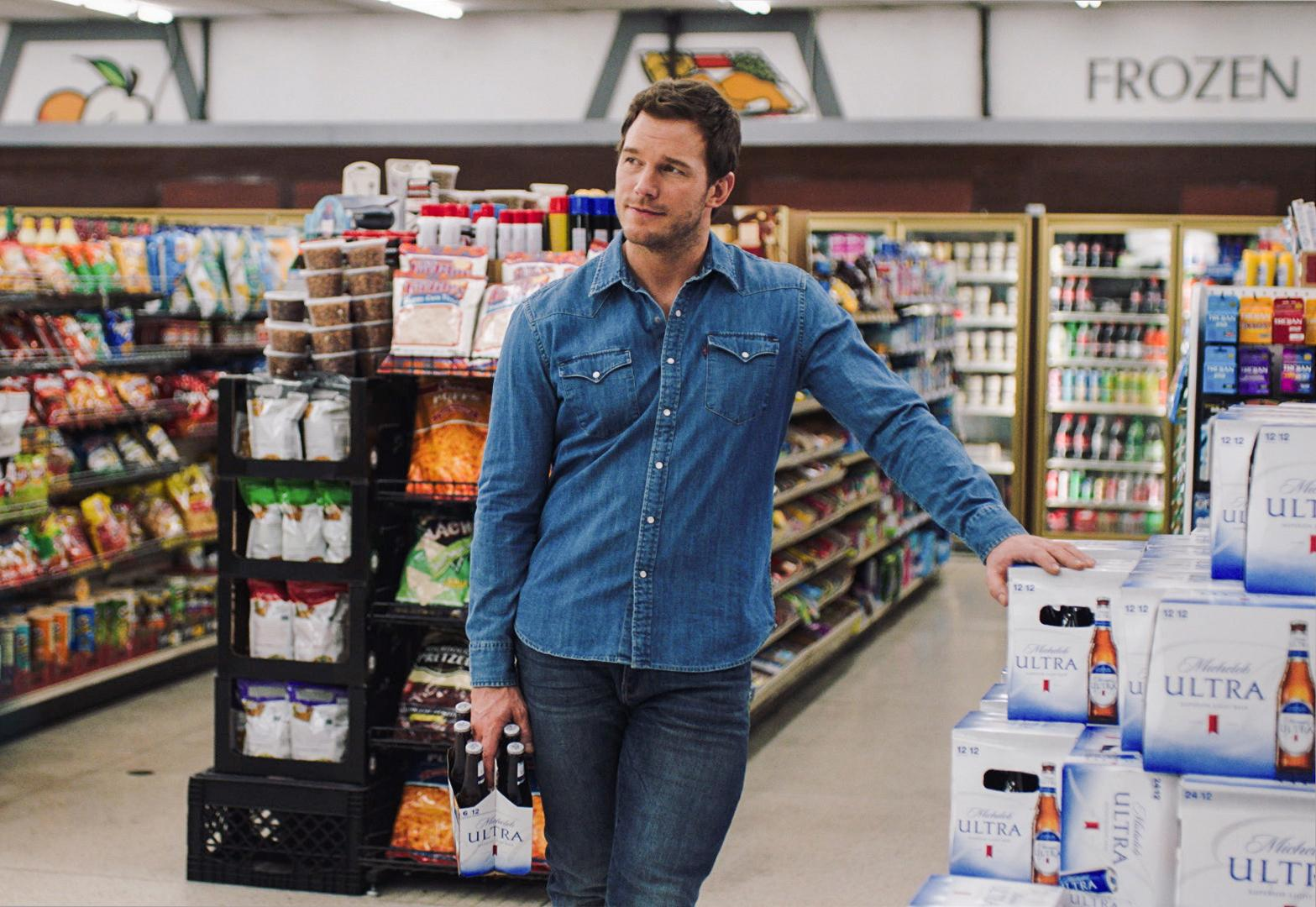 "This image released by Anheuser-Busch shows actor Chris Pratt in a scene from a Michelob Ultra commercial. Pratt, the star of the ""Jurassic World"" and ""Guardians of the Galaxy"" film franchises, will make his advertising debut on Super Bowl Sunday, Feb. 4, 2018, in a pair of commercials for the light beer. (Anheuser-Busch via AP)"