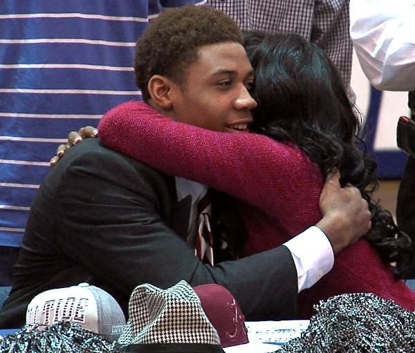 Fultondale athlete ArDarius Stewart hugs his mother after signing his letter of intent to play football at the University of Alabama on National Signing Day, Wednesday, February 6, 2013.
