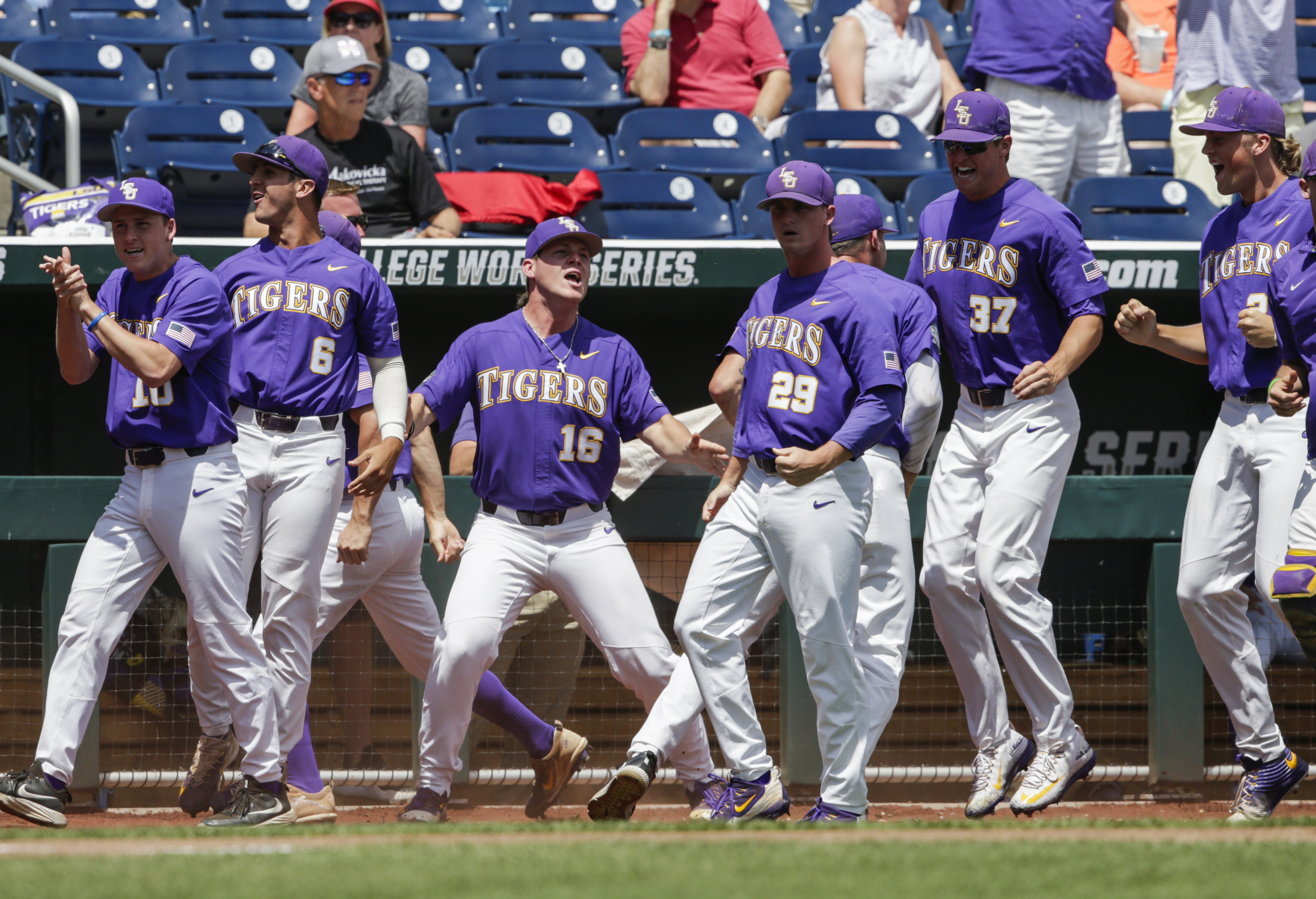 LSU players, including Jared Poche (16), celebrate after Michael Papierski scored a three-run home run against Oregon State in the third inning of an NCAA College World Series baseball elimination game in Omaha, Neb., Saturday, June 24, 2017. (AP Photo/Nati Harnik)