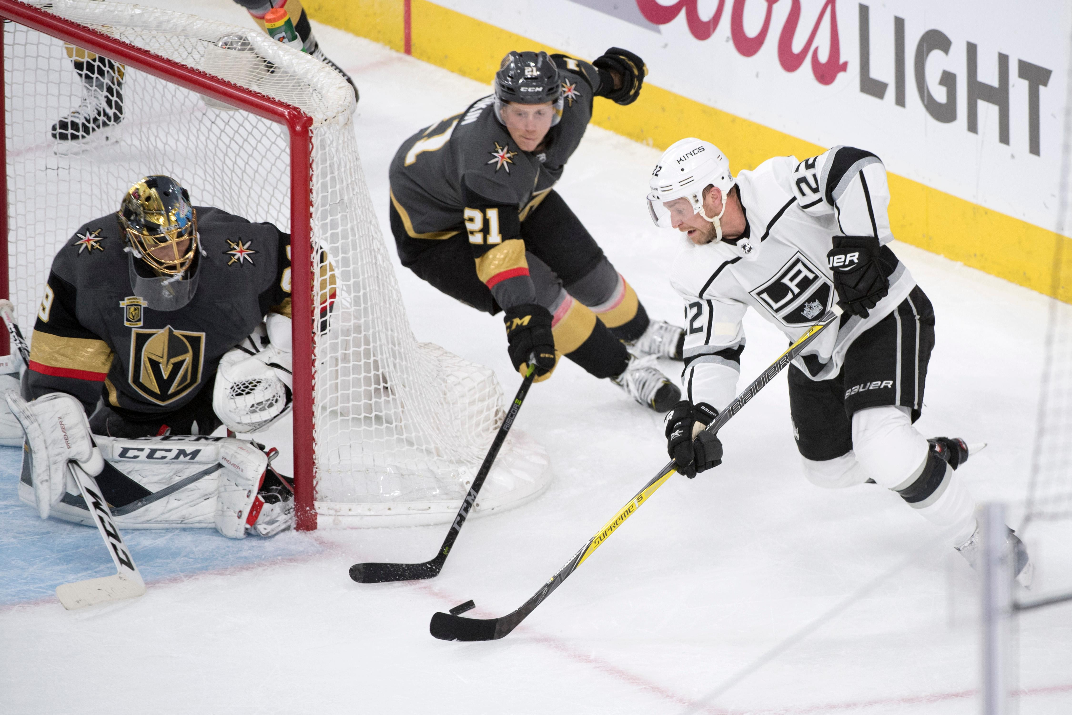 Los Angeles Kings center Trevor Lewis (22) is defended by Vegas Golden Knights center Cody Eakin (21) as he tries to make a wrap around shot during the second period of Game 1 of their NHL hockey first-round playoff series Wednesday, April 11, 2018 at T-Mobile Arena. The Knights won 1-0. CREDIT: Sam Morris/Las Vegas News Bureau