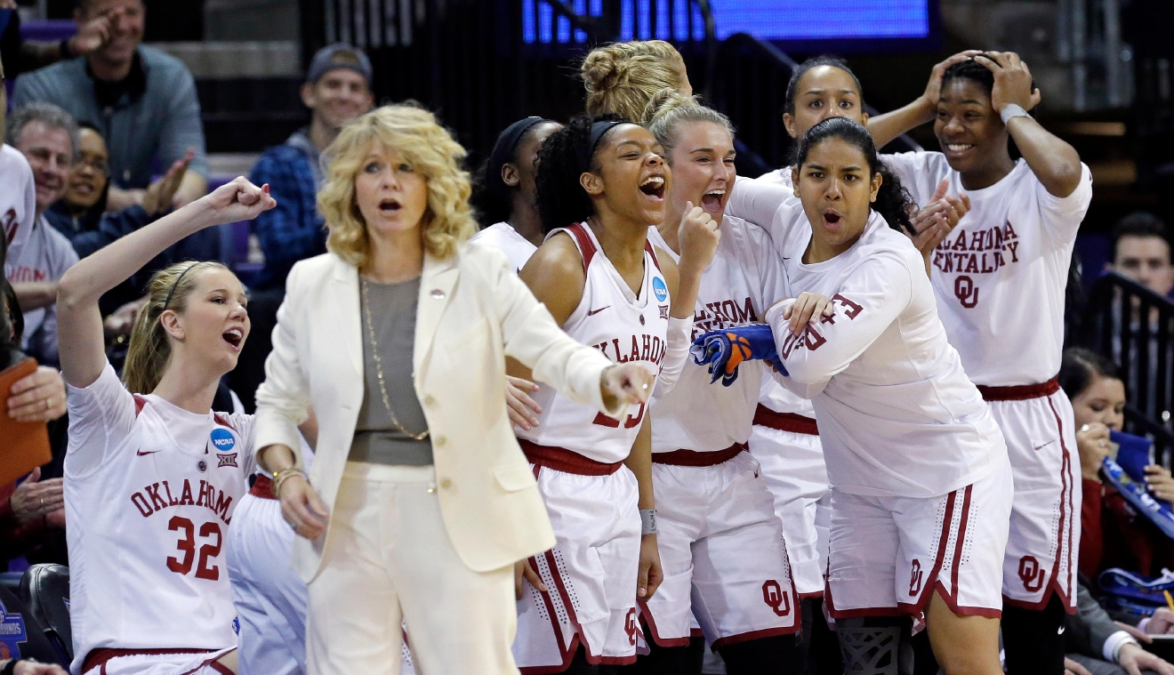 Players on the bench behind Oklahoma head coach Sherri Coale react as their team pulls further ahead against Gonzaga during the first half of a first-round game in the NCAA women's college basketball tournament Saturday, March 18, 2017, in Seattle. (AP Photo/Elaine Thompson)